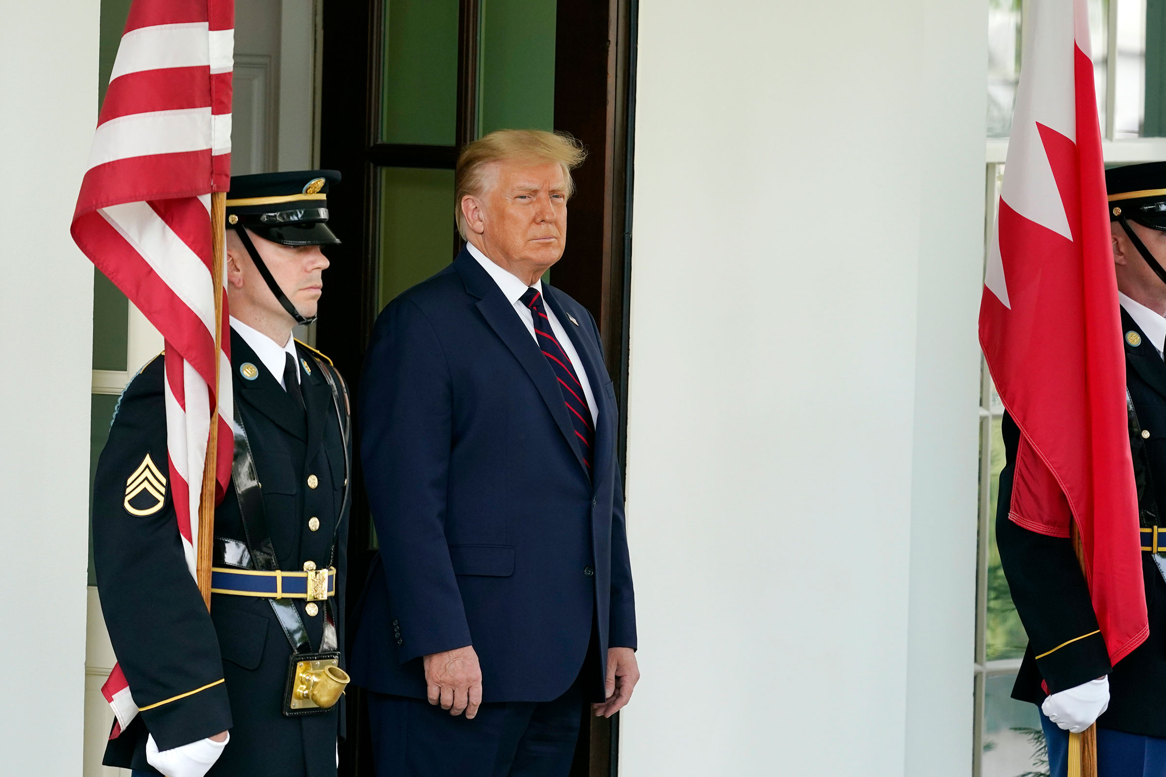 President Donald Trump waits to greet the Bahrain Foreign Minister Khalid bin Ahmed Al Khalifa at the White House, on Sept. 15, 2020, in Washington.