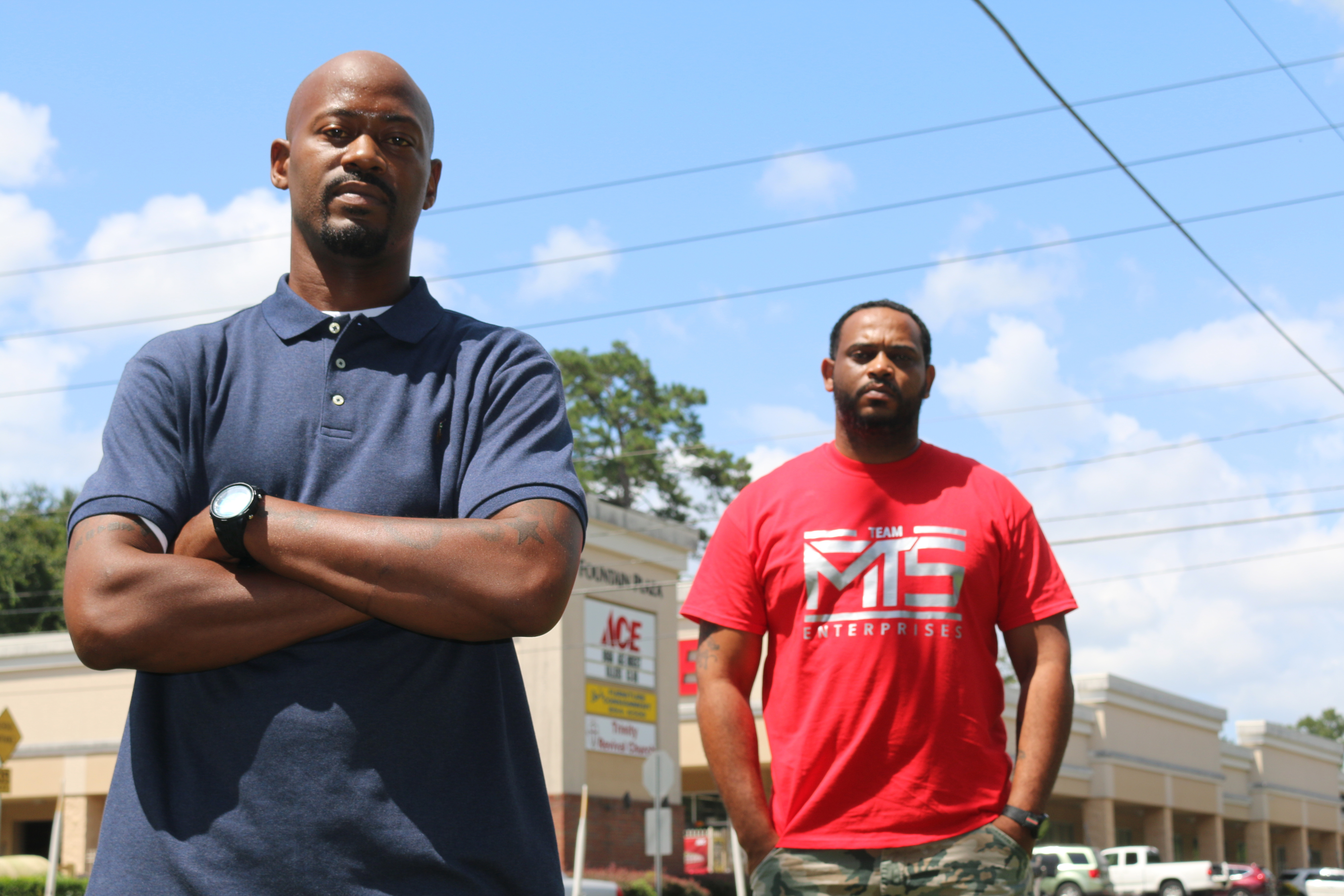 Kendrik Clemons, left, and Charles McMillon pose for a photo on Sept. 2, 2020, in Tallahassee, Florida. The two are raising concerns about an incident a week earlier in which a white couple fired shots at them in what the men call a case of racial profiling.