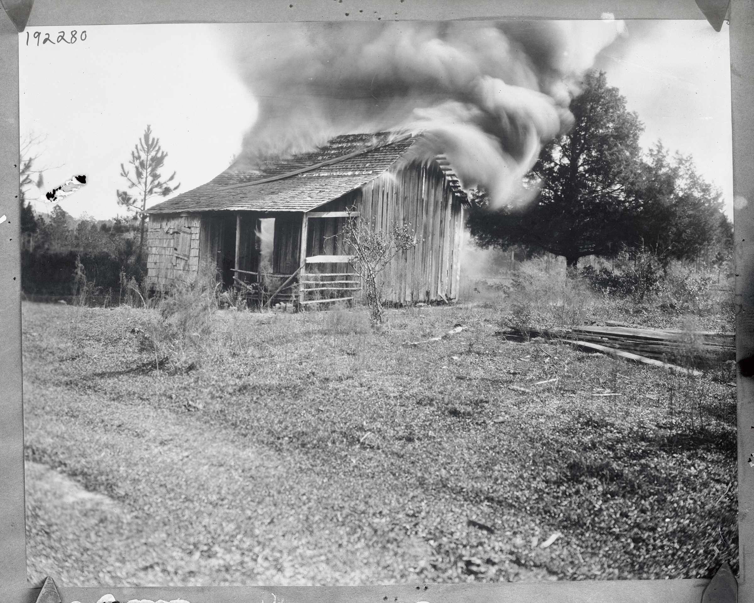 A home burns on Jan. 9, 1923, during a white mob's attacks on the Black community of Rosewood, Fla.