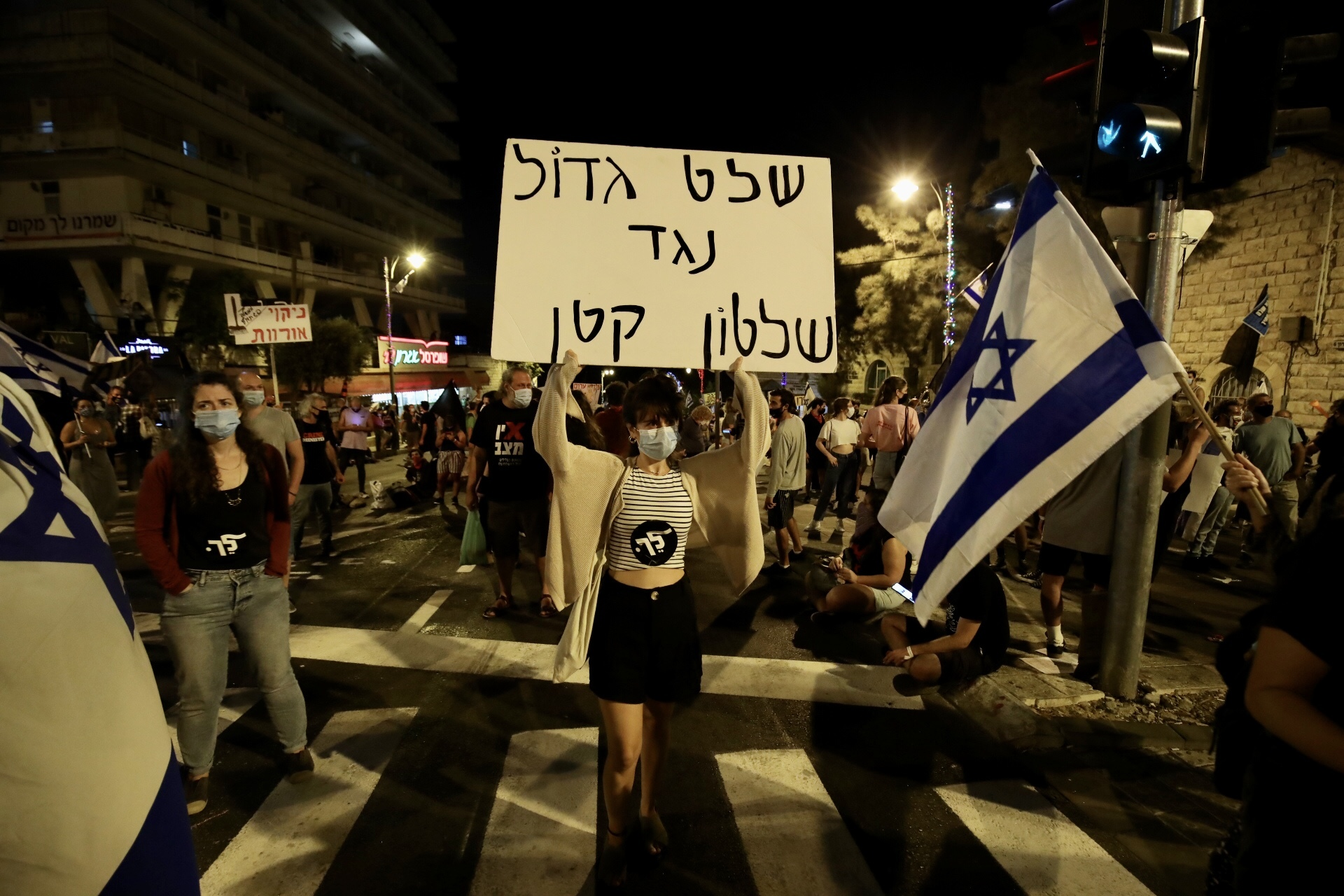 People protest against the Israeli Prime Minister Benjamin Netanyahu, demanding his resignation over corruption cases and his failure to combat the new type of coronavirus (Covid-19) pandemic in West Jerusalem on Sept. 26, 2020.