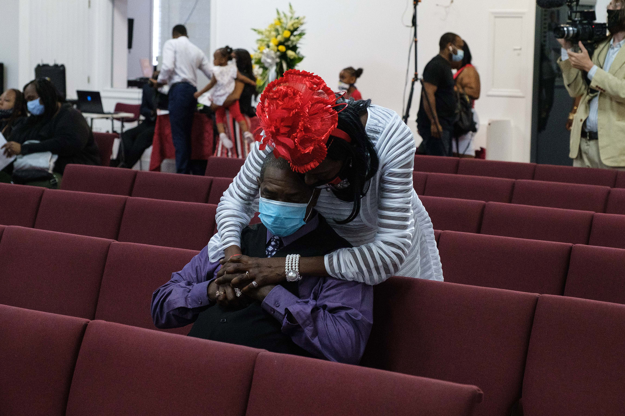 Donna Mays hugs Jamel Floyd's cousin Mark Lumpkin during the funeral on June 30.