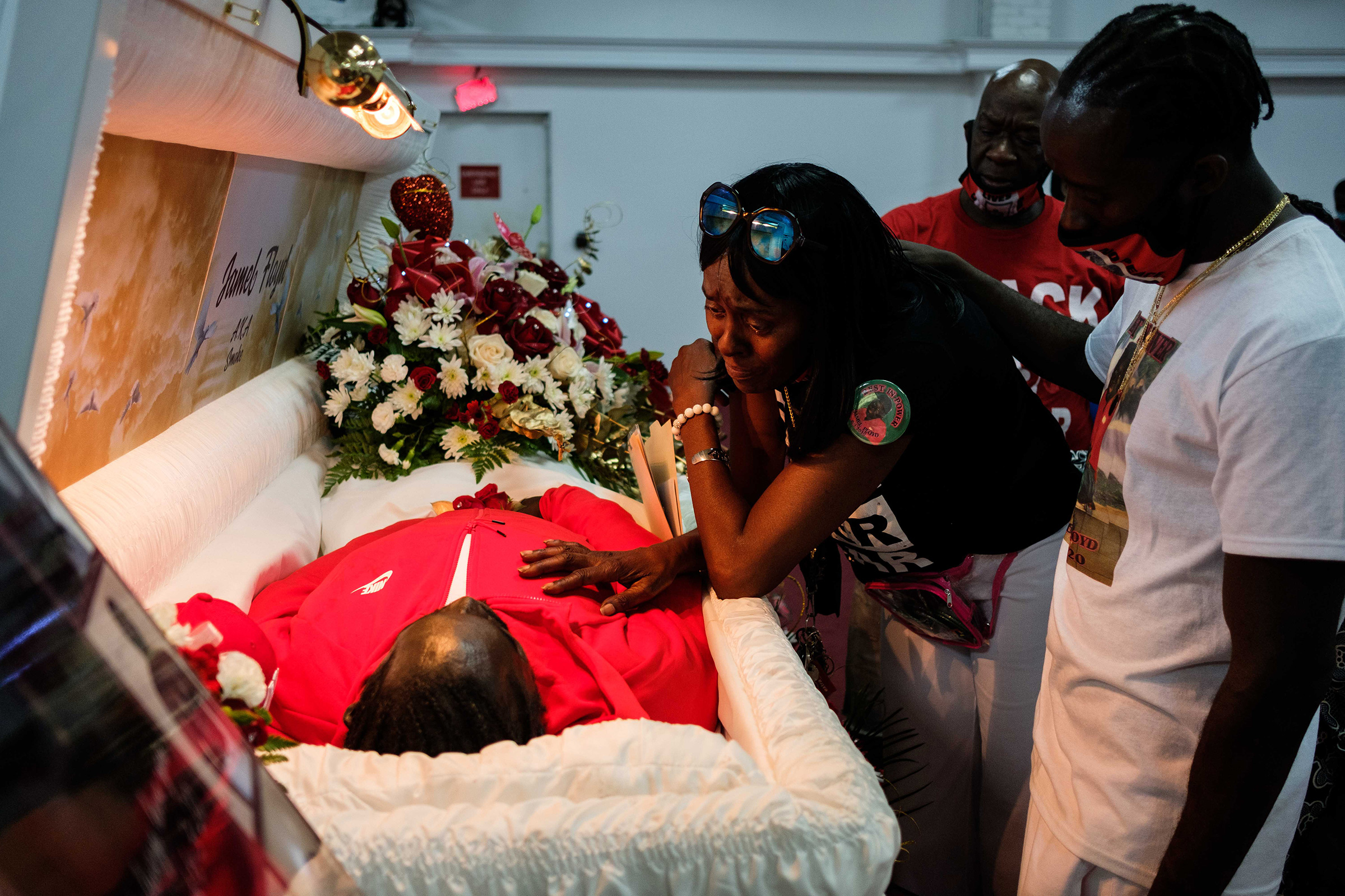 Donna Mays, Jamel Floyd's mother, looks down at her son's body during the wake at Judea United Baptist Church in Hempstead, N.Y., on June 29.