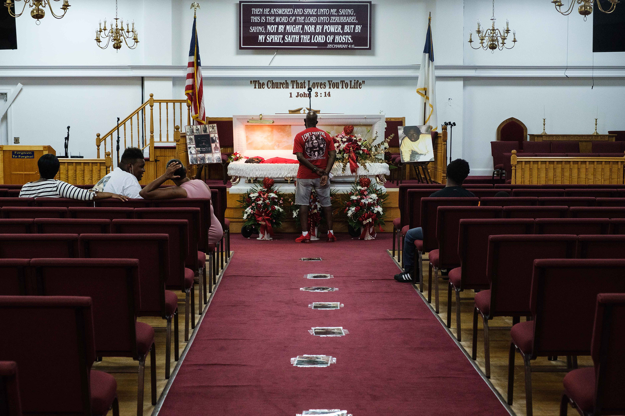 James Floyd, Jamel Floyd's father, looks over his son's body during the wake at Judea United Baptist Church in Hempstead, N.Y., on June 29.