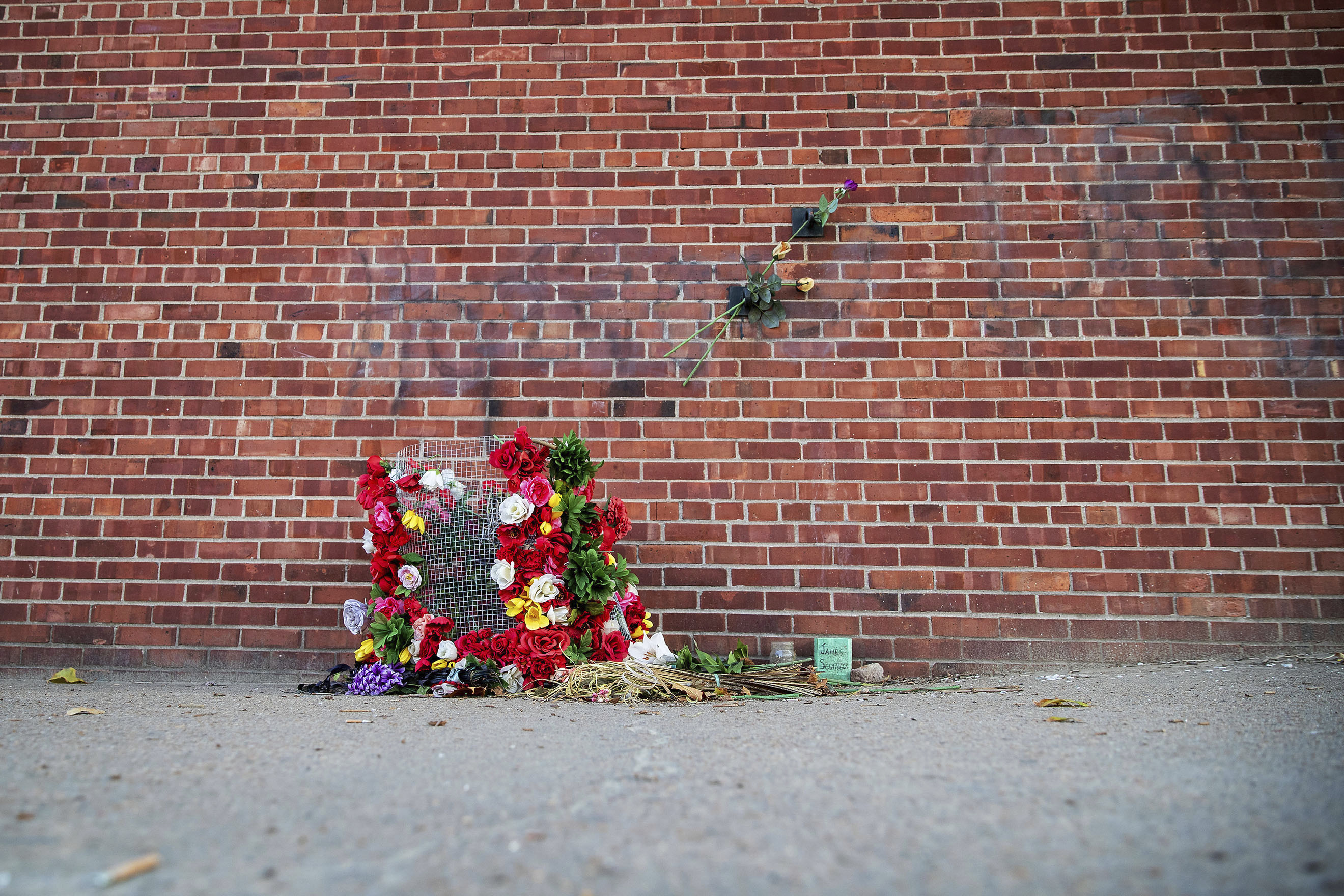 A memorial for James Scurlock sits near 12th and Harney Streets on Sept. 15, 2020 in Omaha, Neb. Charges were filed Tuesday against Jake Gardner, who shot Scurlock on May 30.
