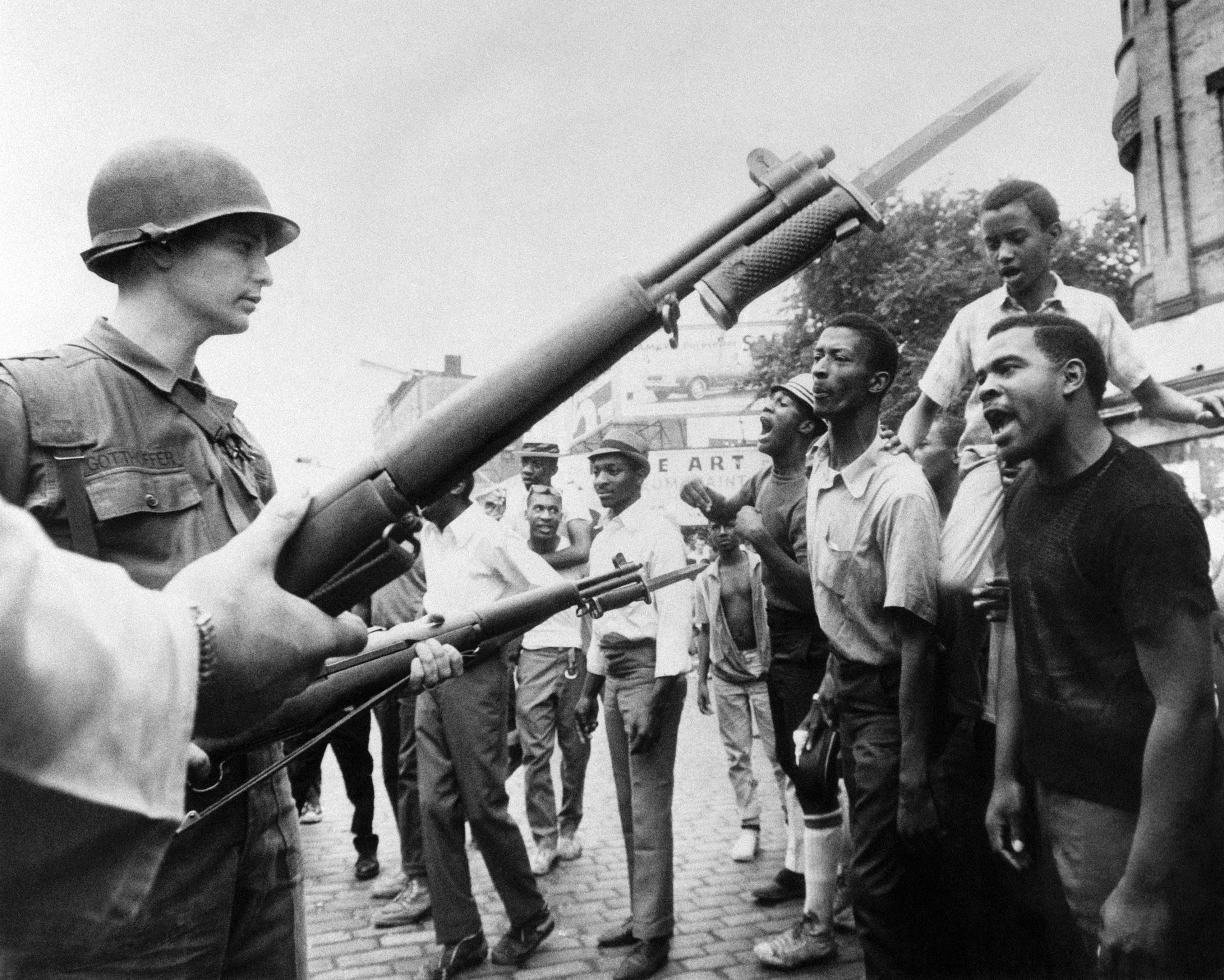 Black demonstrators face armed federal soldiers in Newark on July 17, 1967 during riots that erupted in the city.