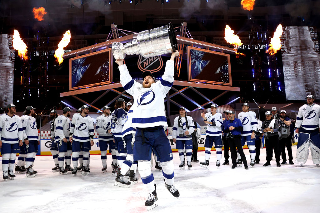 Blake Coleman #20 of the Tampa Bay Lightning hoists the Stanley Cup overhead after the                  Tampa Bay Lightning defeated the Dallas Stars 2-0 in Game Six of the NHL Stanley Cup Final to win the best of seven game series 4-2 at Rogers Place on September 28, 2020 in Edmonton, Alberta, Canada.