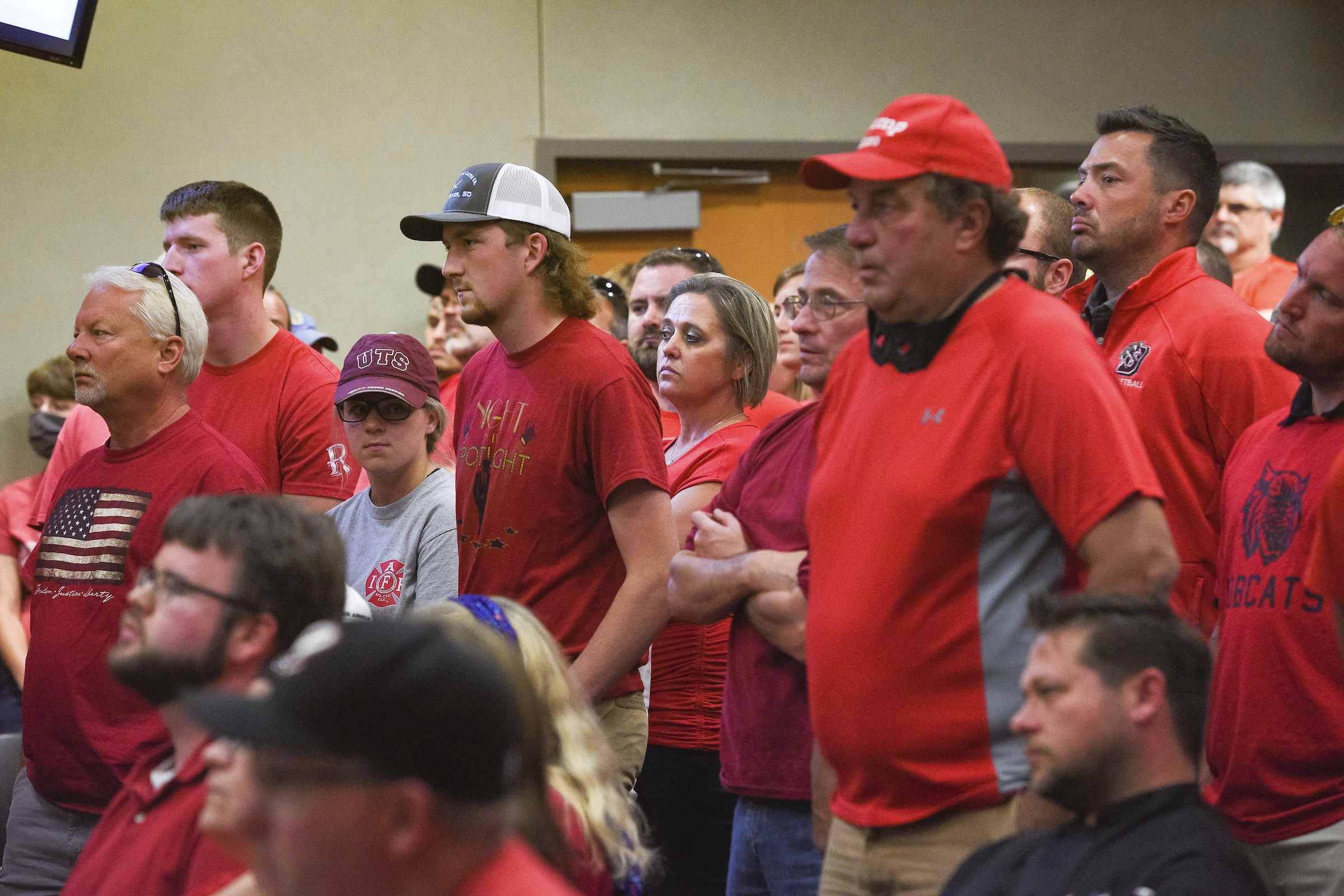 Over 200 people wear red in solidarity against a potential city-wide mask mandate during a city council meeting on Sept. 2, in Brookings, S.D.