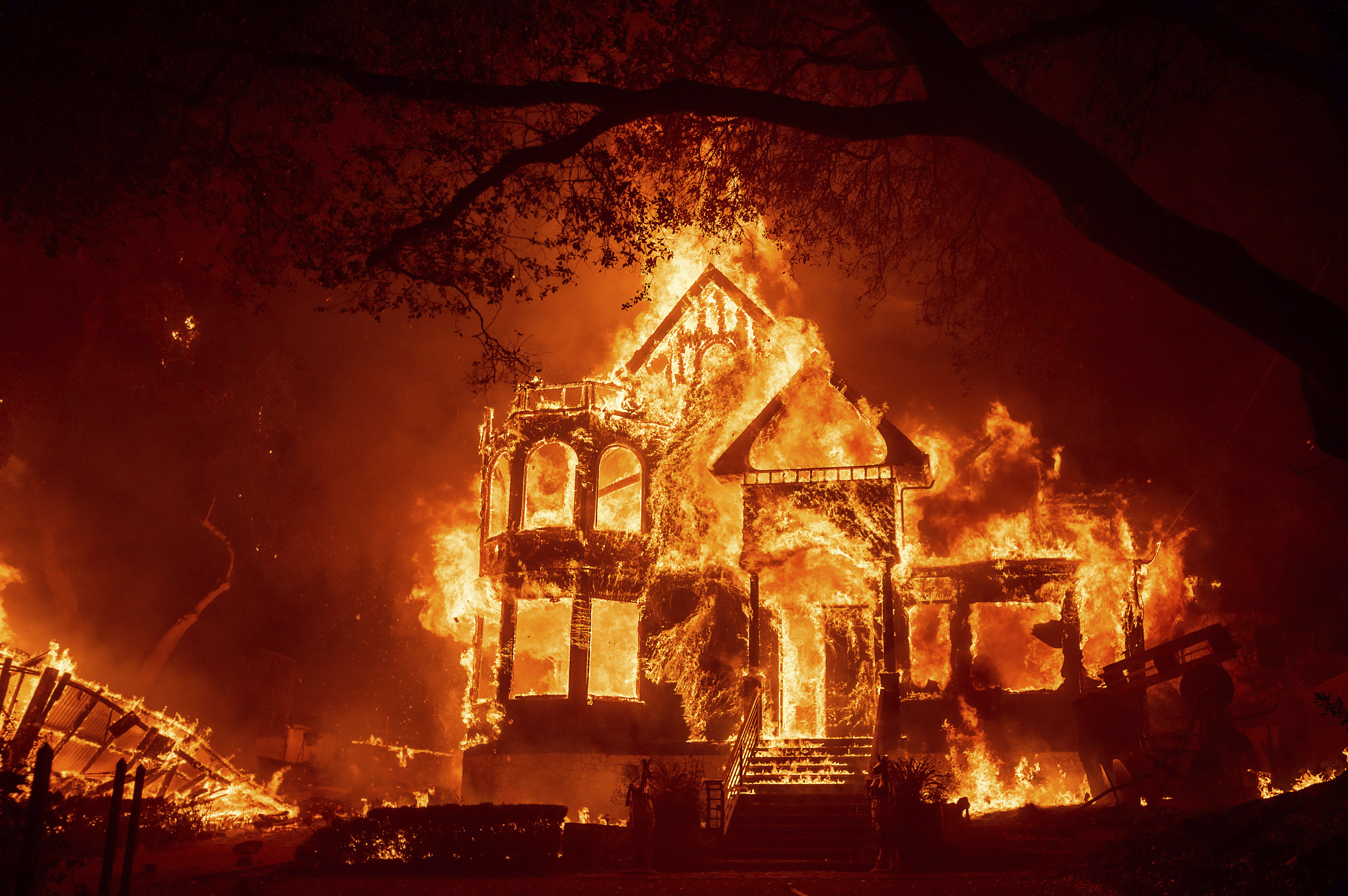 Flames from the Glass Fire consume the Black Rock Inn on Sept. 27, 2020, in St. Helena, Calif.