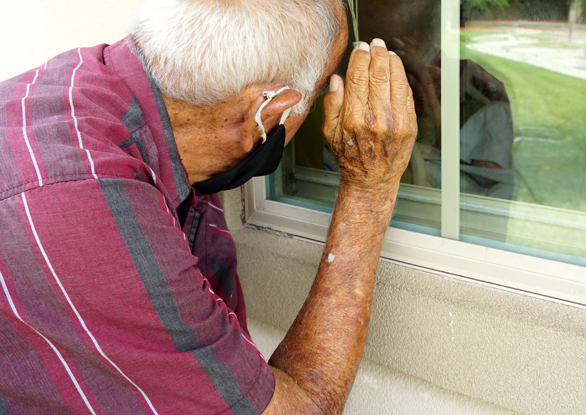 Seventy-year-old Jacobo Garcia visits his wife of 54 years Aurora Garcia on Aug. 25, 2020, at her bedside window just to see her smile at Fox Hollow Post Acute Nursing Home in Brownsville, Texas. Jacobo visits Aurora everyday amid the COVID-19 pandemic.