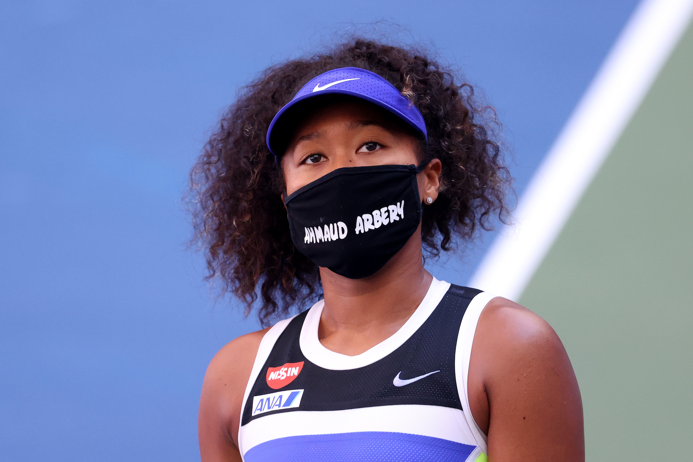 Naomi Osaka of Japan wears a protective face mask with the name Ahmaud Arbery stenciled on it after winning her Women's Singles third round match on Day Five of the 2020 U.S. Open in New York City.