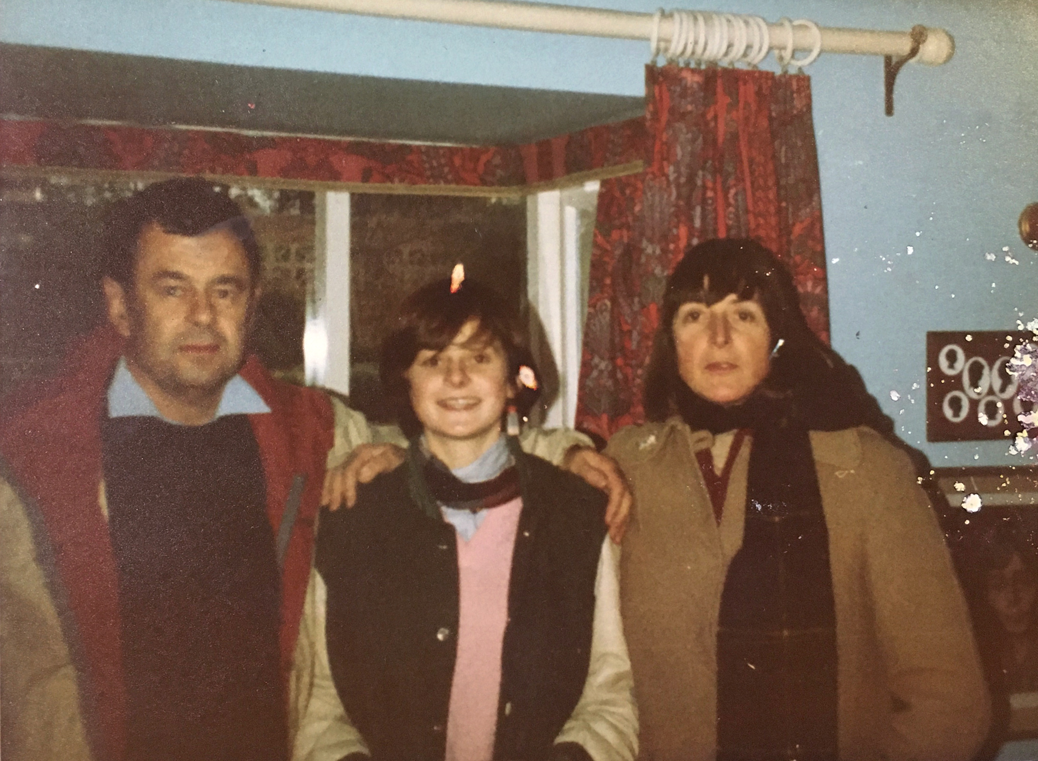 with her parents, circa 1983.