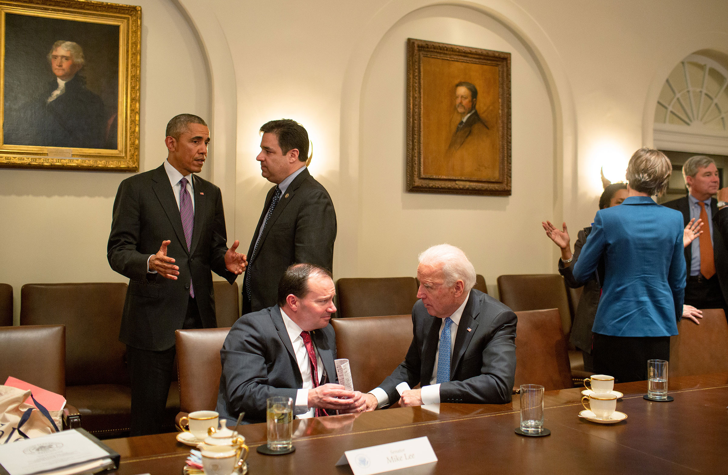 President Barack Obama talks with Rep. Rual Labrador as Vice President Joe Biden talks with Sen. Mike Lee following a meeting with bipartisan Members of Congress to discuss criminal justice reform, in the Cabinet Room of the White House, on Feb. 24, 2015.