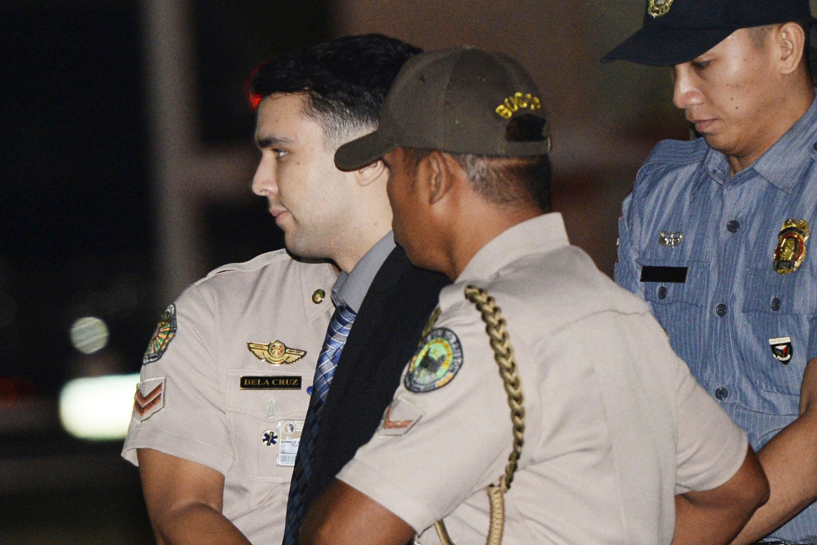 In this Dec. 1, 2015, file photo, convicted U.S. Marine Lance Cpl. Joseph Scott Pemberton is escorted to his detention cell upon arrival at Camp Aguinaldo at suburban Quezon city, northeast of Manila, Philippines.
