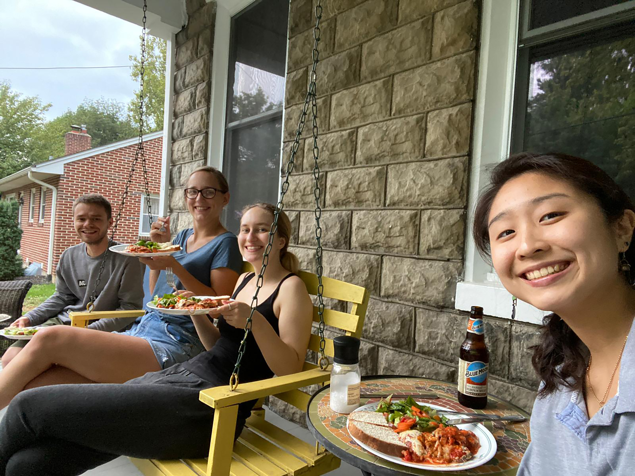 The author (right) having dinner with her housemates on the porch in Carlisle, Penn.