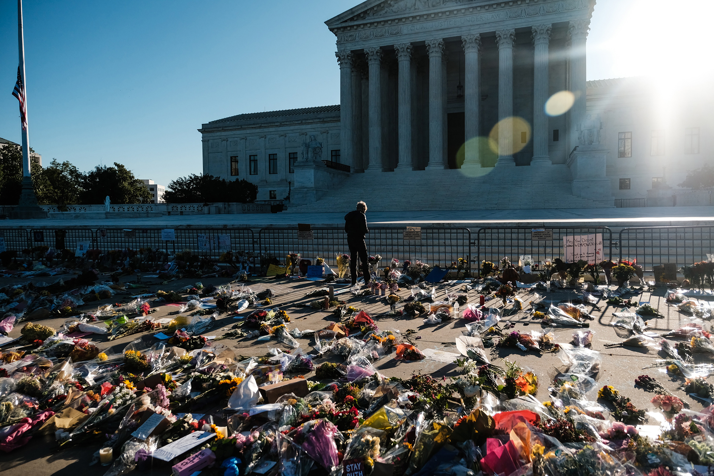 A mourner pays their respects at a makeshift memorial outside the Supreme Court building in Washington, on Sept. 20