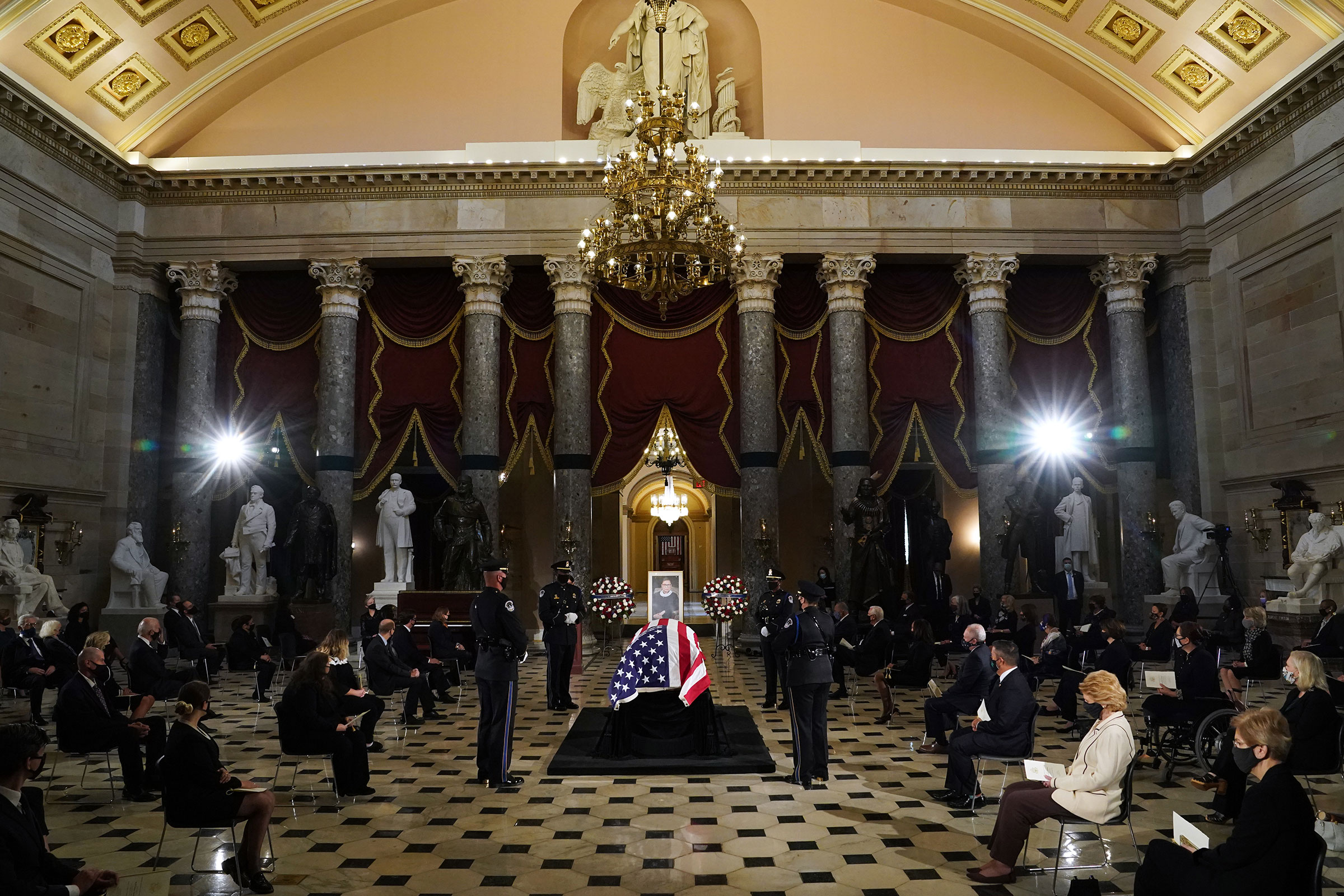 The flag-draped casket of the late Associate Justice Ruth Bader Ginsburg lies in state in Statuary Hall of the US Capitol during a memorial service in her honor on Sept. 25, 2020.