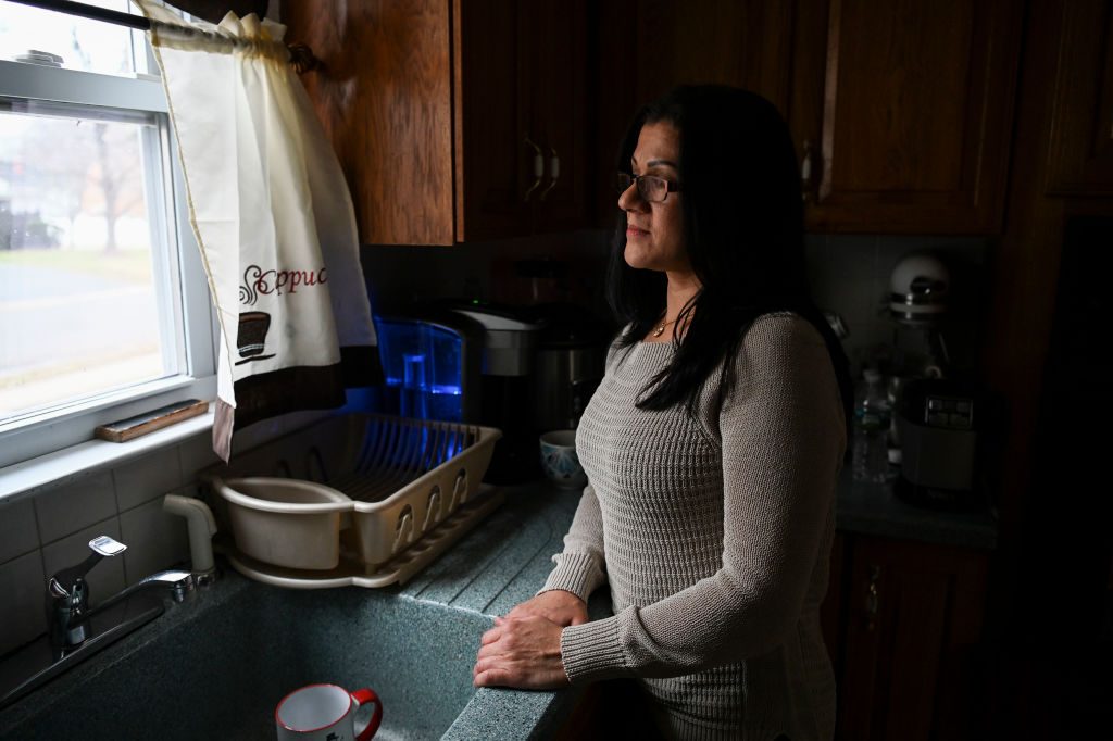 Sandra Diaz, who worked at the Trump National Golf Club Bedminster before getting her Green Card, poses for a portrait at home in Bound Brook, NJ on January 7, 2019.