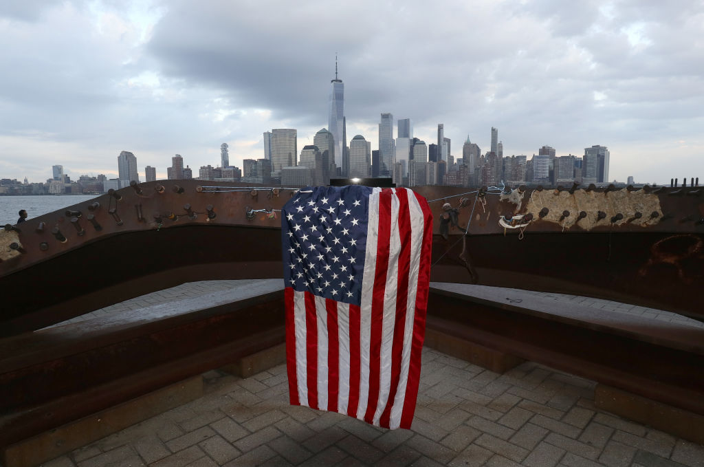 A flag hangs on a 9/11 Memorial featuring twisted steel from the original World Trade Center in Jersey City, New Jersey on Aug. 17, 2020.