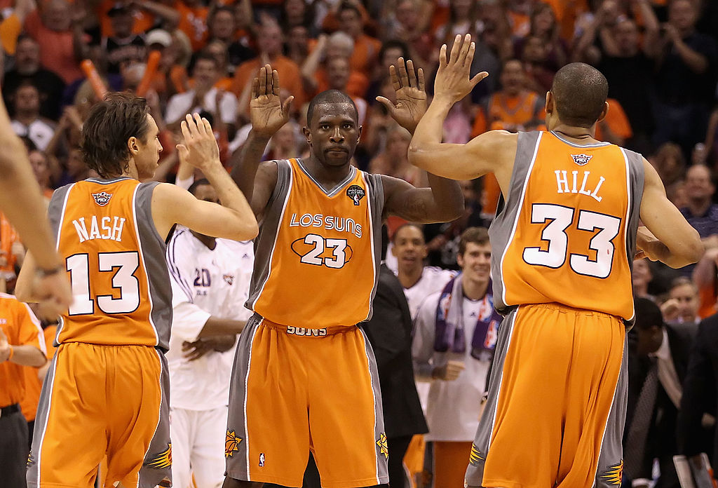 Jason Richardson #23 of the Phoenix Suns high-fives teammates Steve Nash #13 and Grant Hill #33 after scoring against the San Antonio Spurs on May 5, 2010 in Phoenix, Ariz.