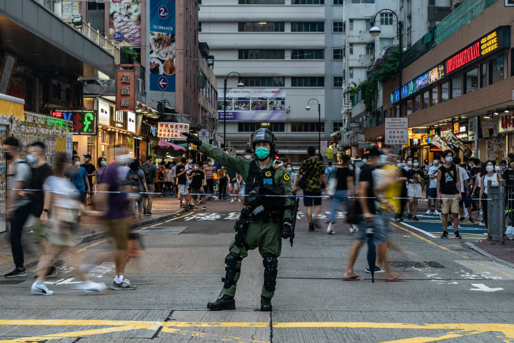 A police officer gestures in front of a cordon during a protest in Hong Kong, China on Sept. 6, 2020.