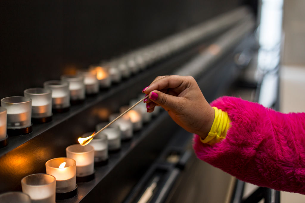 A visitor lights a candle in the Hall of Remembrance at the United States Holocaust Memorial Museum in Washington, D.C., on Nov. 25, 2018.