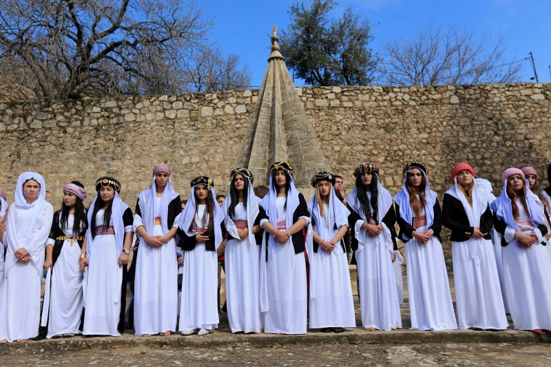 Yazidi women at a ceremony to commemorate the death of women killed by the Islamic State in Shikham, Iraq, on March 8, 2019.