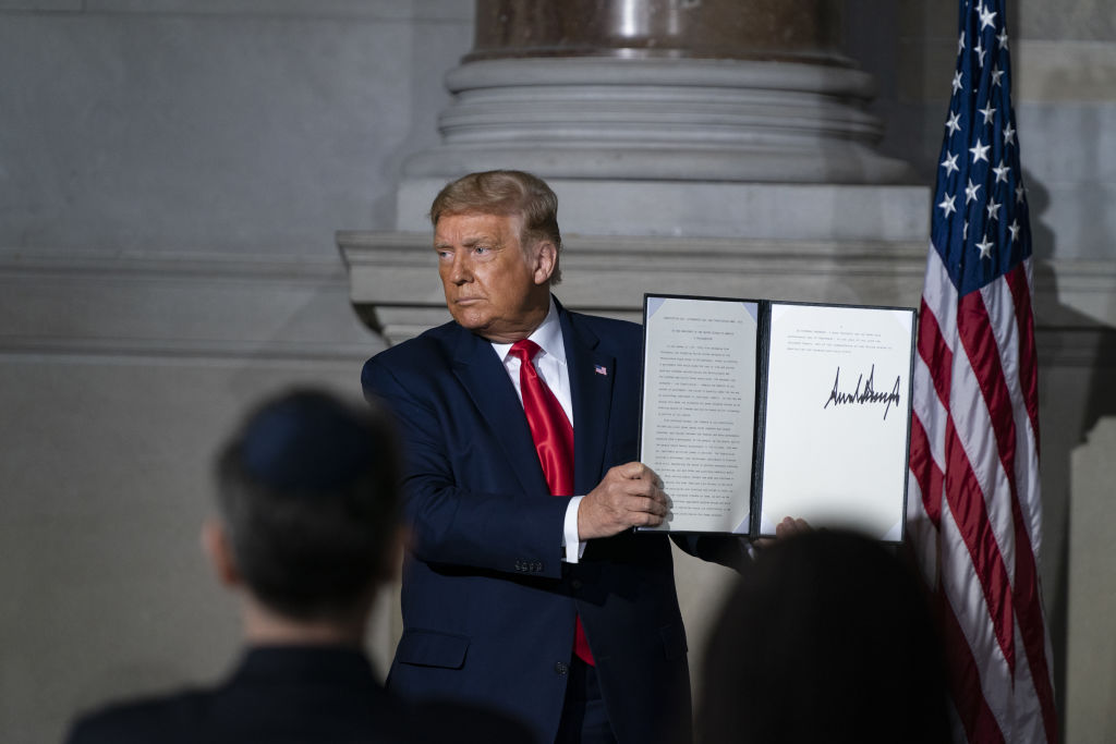 U.S. President Donald Trump holds up a proclamation at the White House Conference on American History at the National Archives in Washington, D.C., on Sept. 17, 2020.