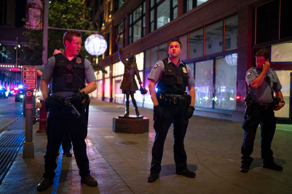 MINNEAPOLIS, MN - AUGUST 26: Minneapolis Police formed a line on the Nicollet Mall near where a Foot Locker store was looted on Aug. 26, 2020.
