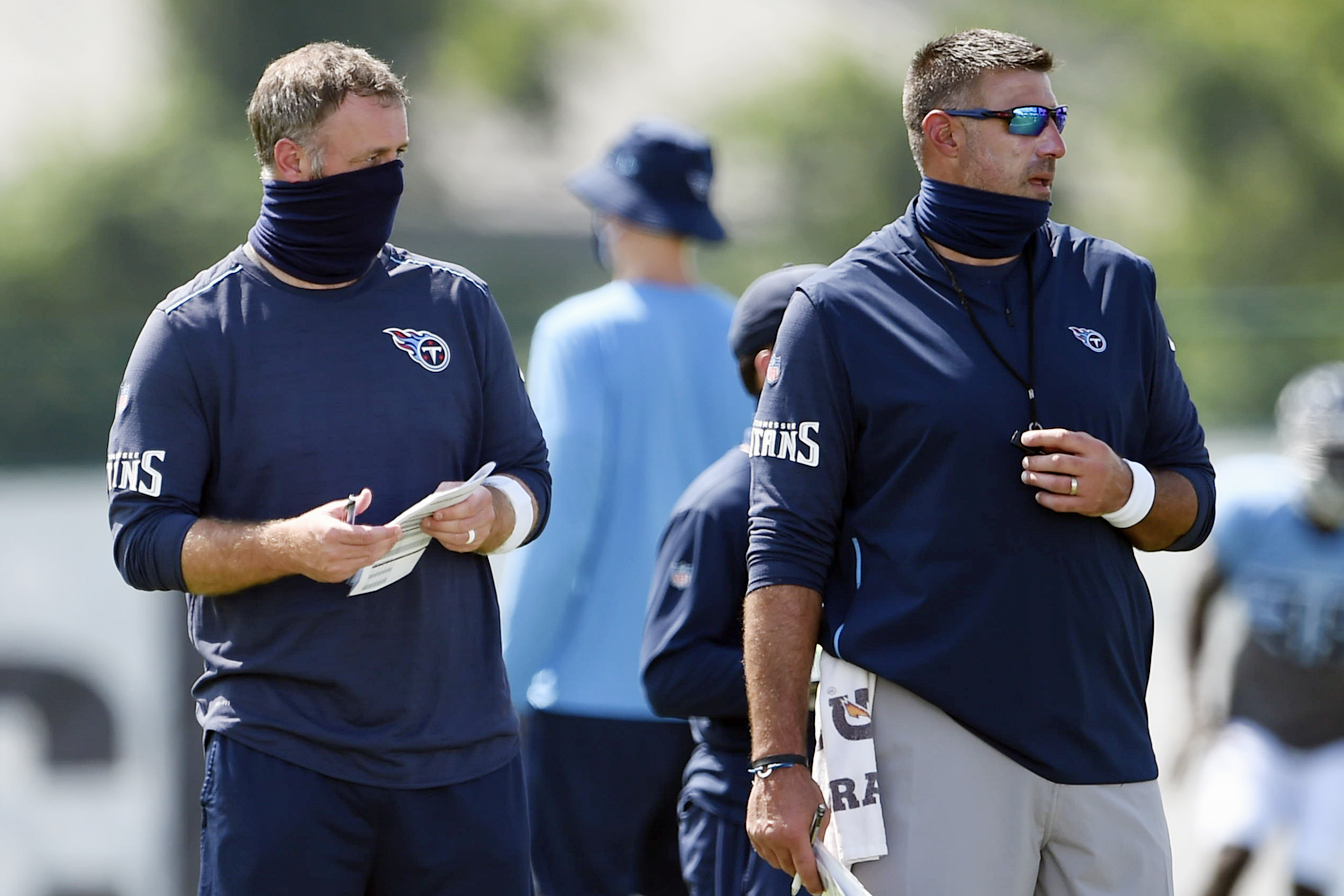 Tennessee Titans outside linebackers coach Shane Bowen, left, and head coach Mike Vrabel watch players during NFL football training camp in Nashville, Tenn., on In Aug. 24, 2020.