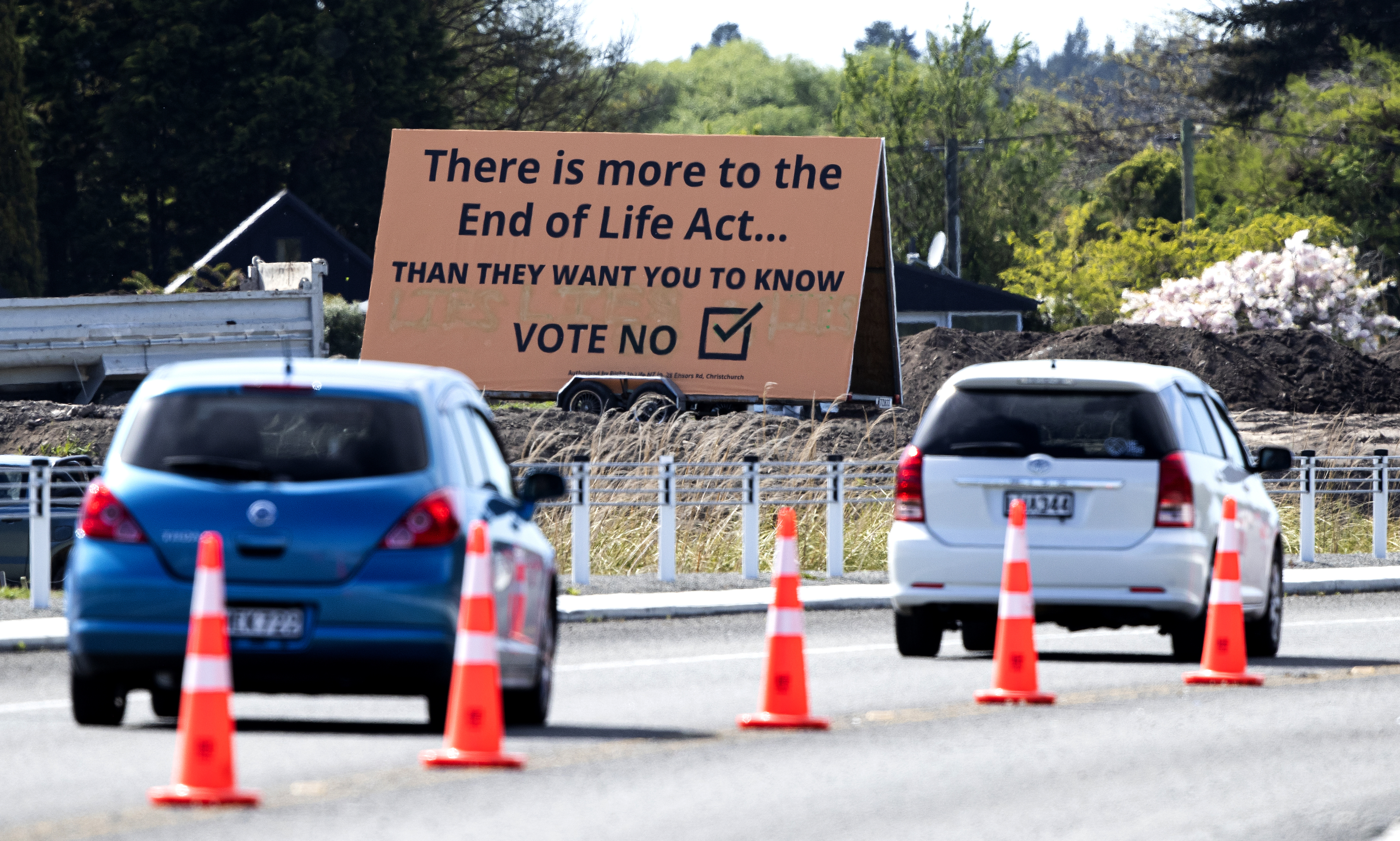 In this Oct. 16, 2020, file photo, cars are driven past a billboard urging voters to vote  No  against euthanasia in Christchurch, New Zealand.