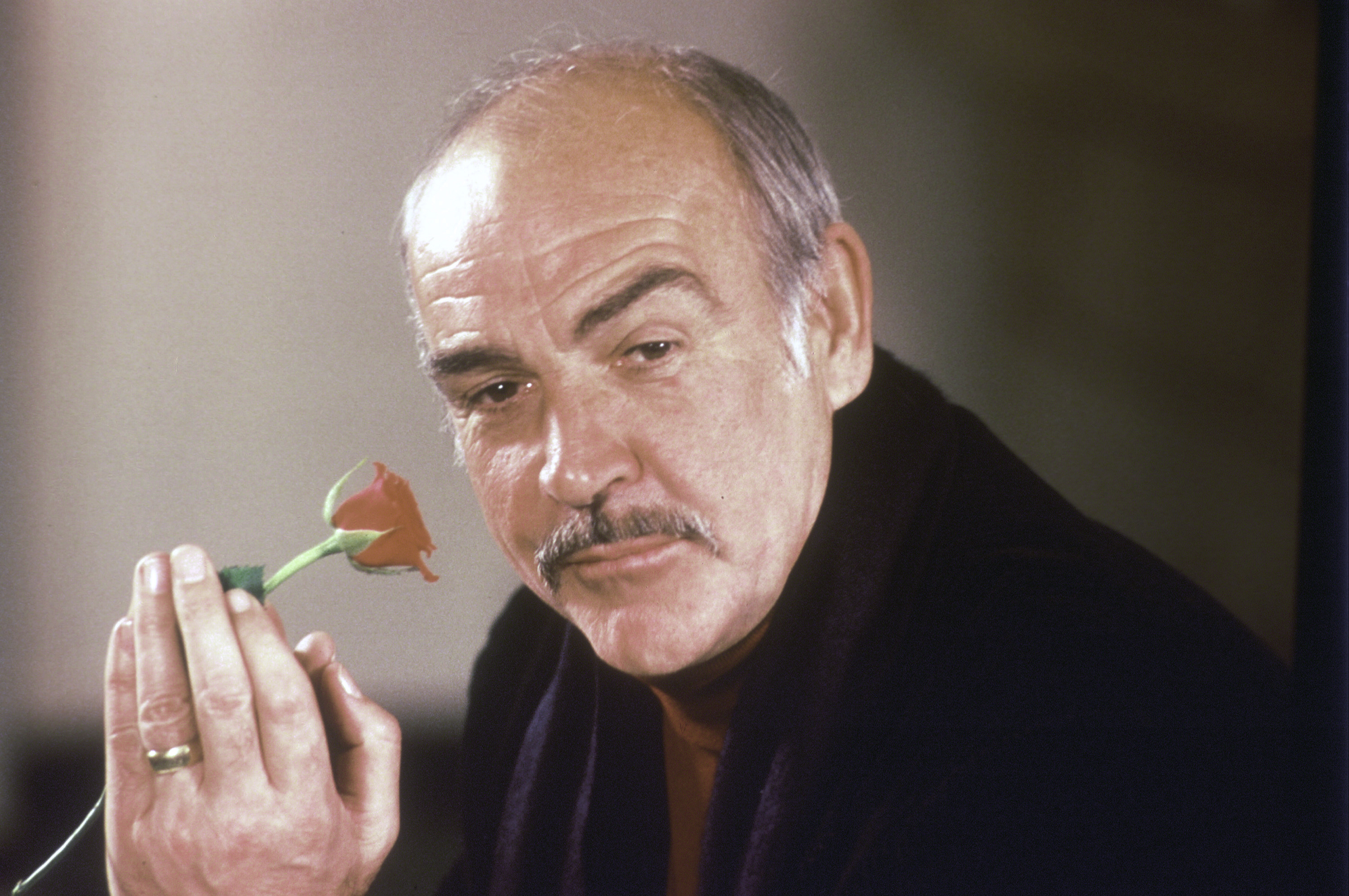 In this photo, actor Sean Connery holds a rose in his hand as he talks about his new movie  The Name of the Rose  at a news conference in London on Jan. 23, 1987.