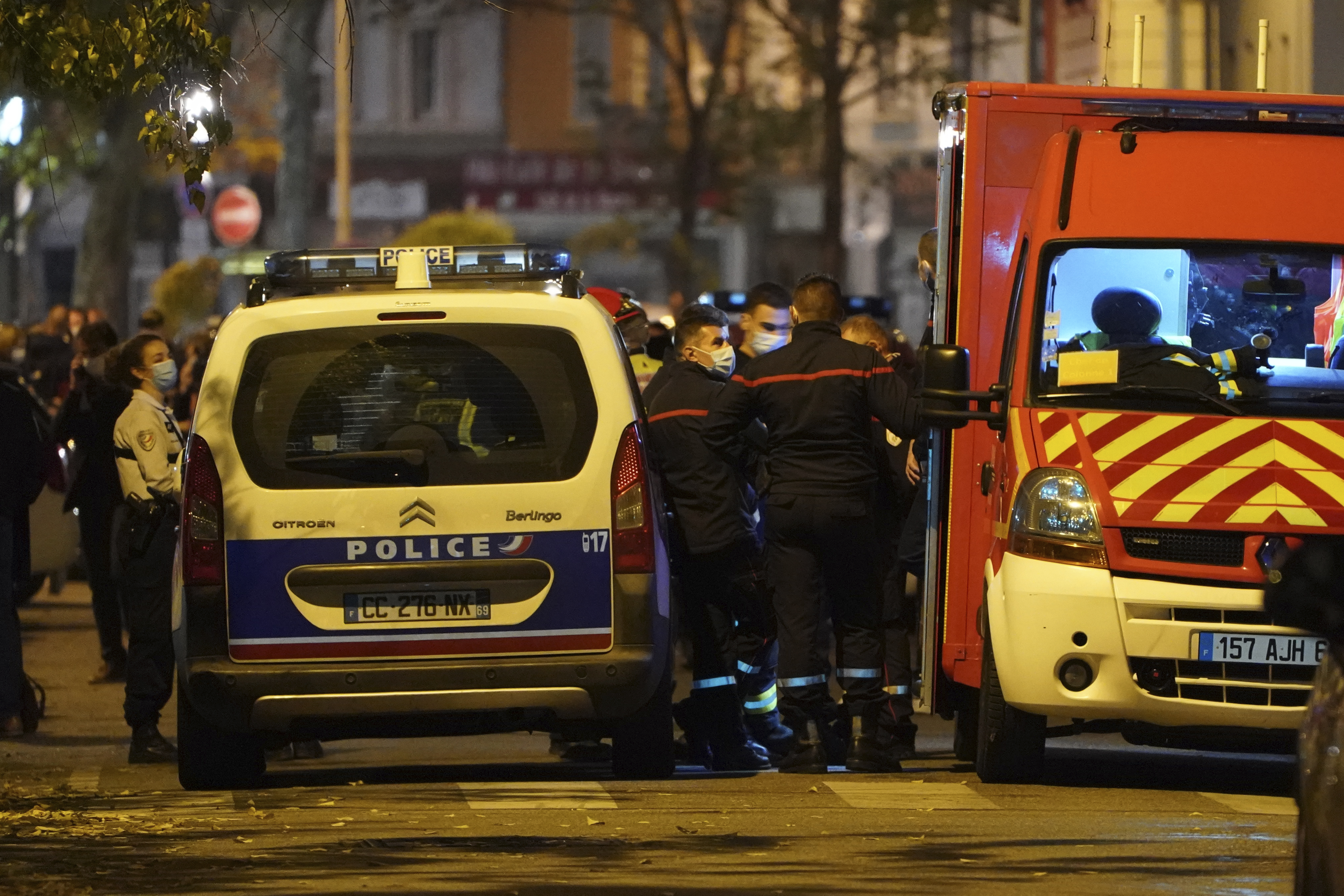 Police officers and rescue workers block the access to the scene after a Greek Orthodox priest was shot  while he was closing his church in the city of Lyon, central France, on Saturday Oct.31, 2020.