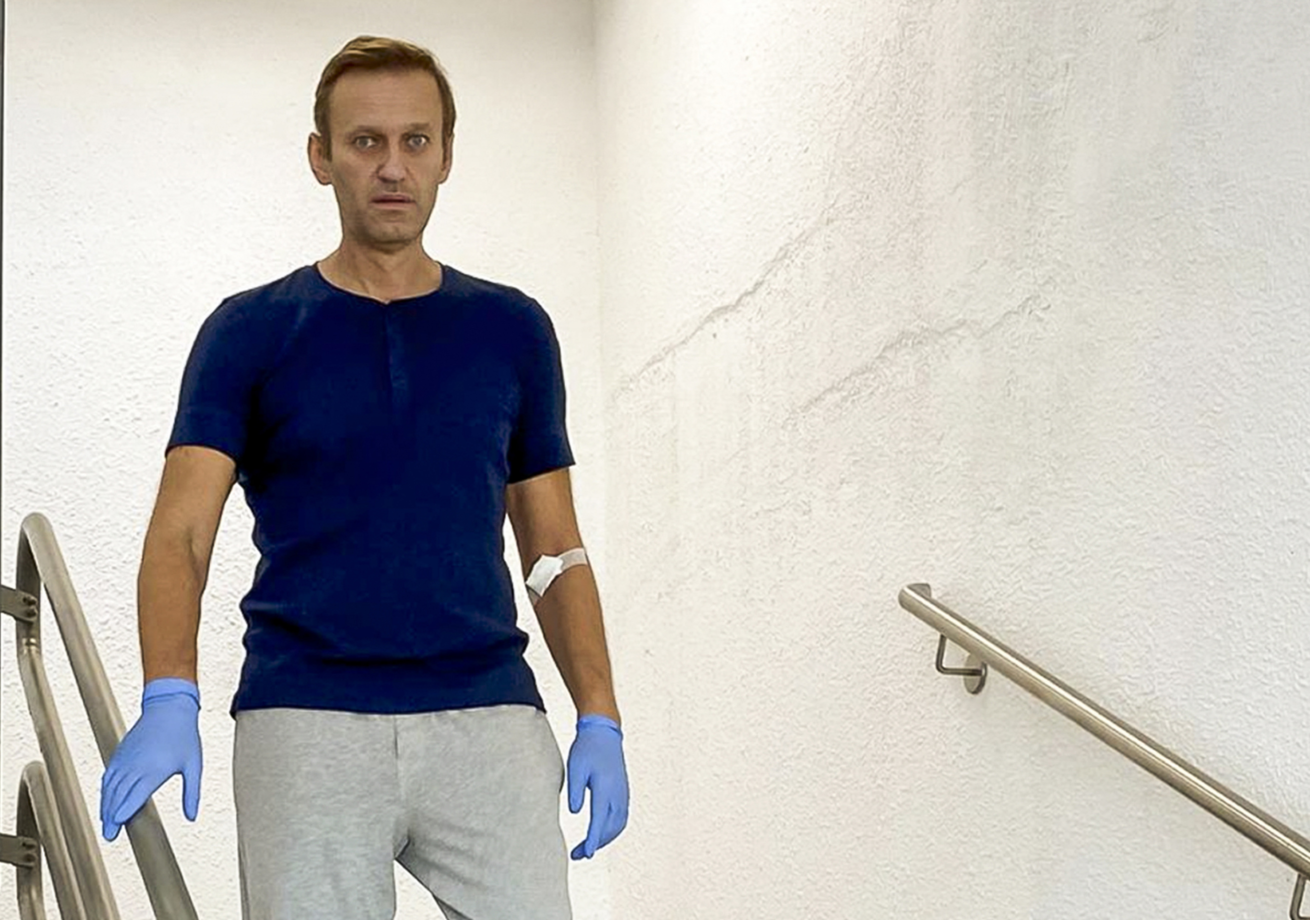 In this photo taken from a video published by Russian opposition leader Alexei Navalny on his instagram account, Russian opposition leader Alexei Navalny walks down stairs in a hospital in Berlin, Germany, Saturday, Sept. 19, 2020. The German hospital treating Russian opposition leader Alexei Navalny for poisoning says his condition improved enough for him to be released from the facility. The Charite hospital in Berlin said Wednesday Sept. 23, 2020 that after 32 days in care, Navalny's condition  improved sufficiently for him to be discharged from acute inpatient care.