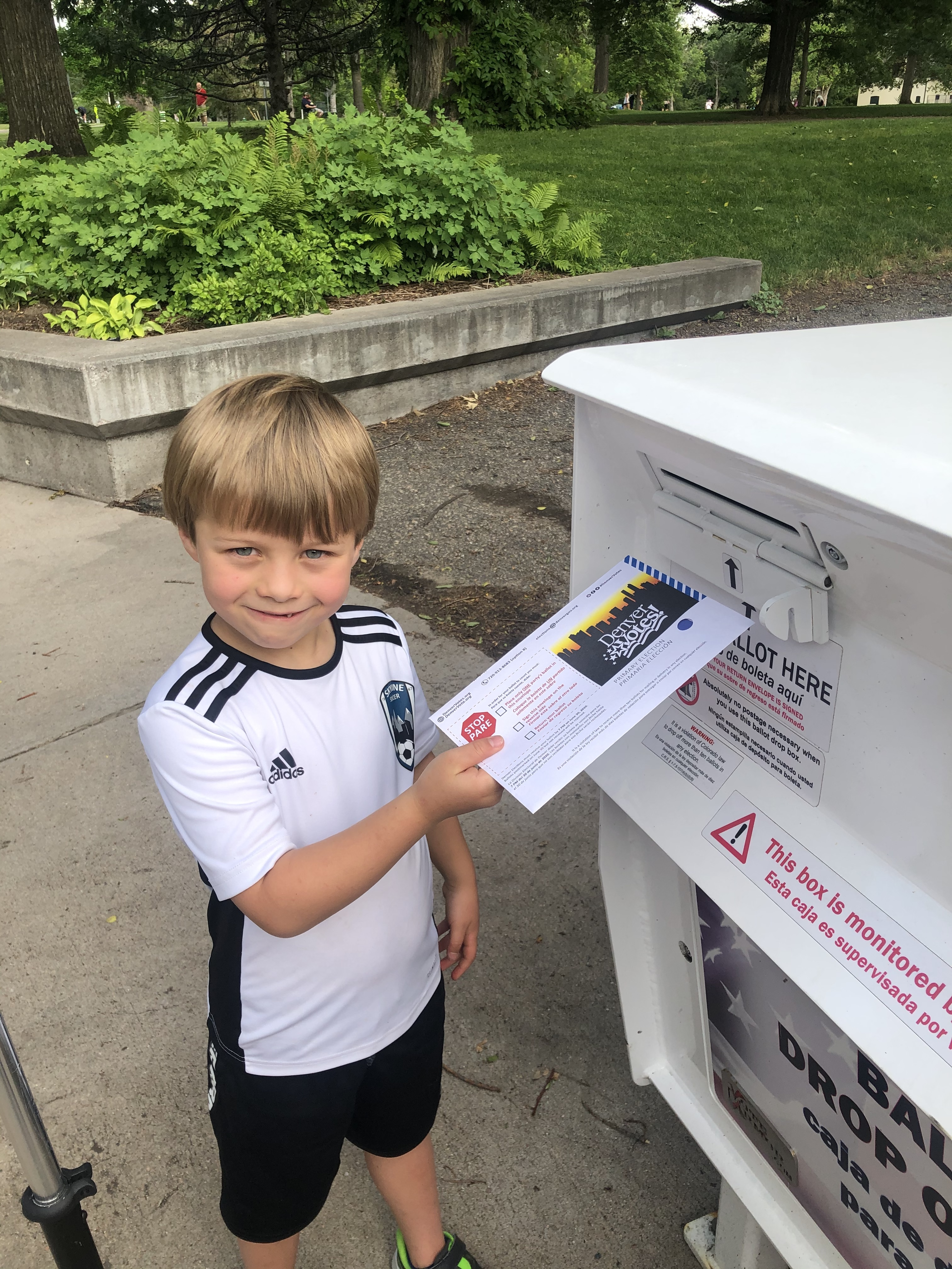 McReynolds' son Kenton, 7, helping her vote during Colorado's primary election this summer.