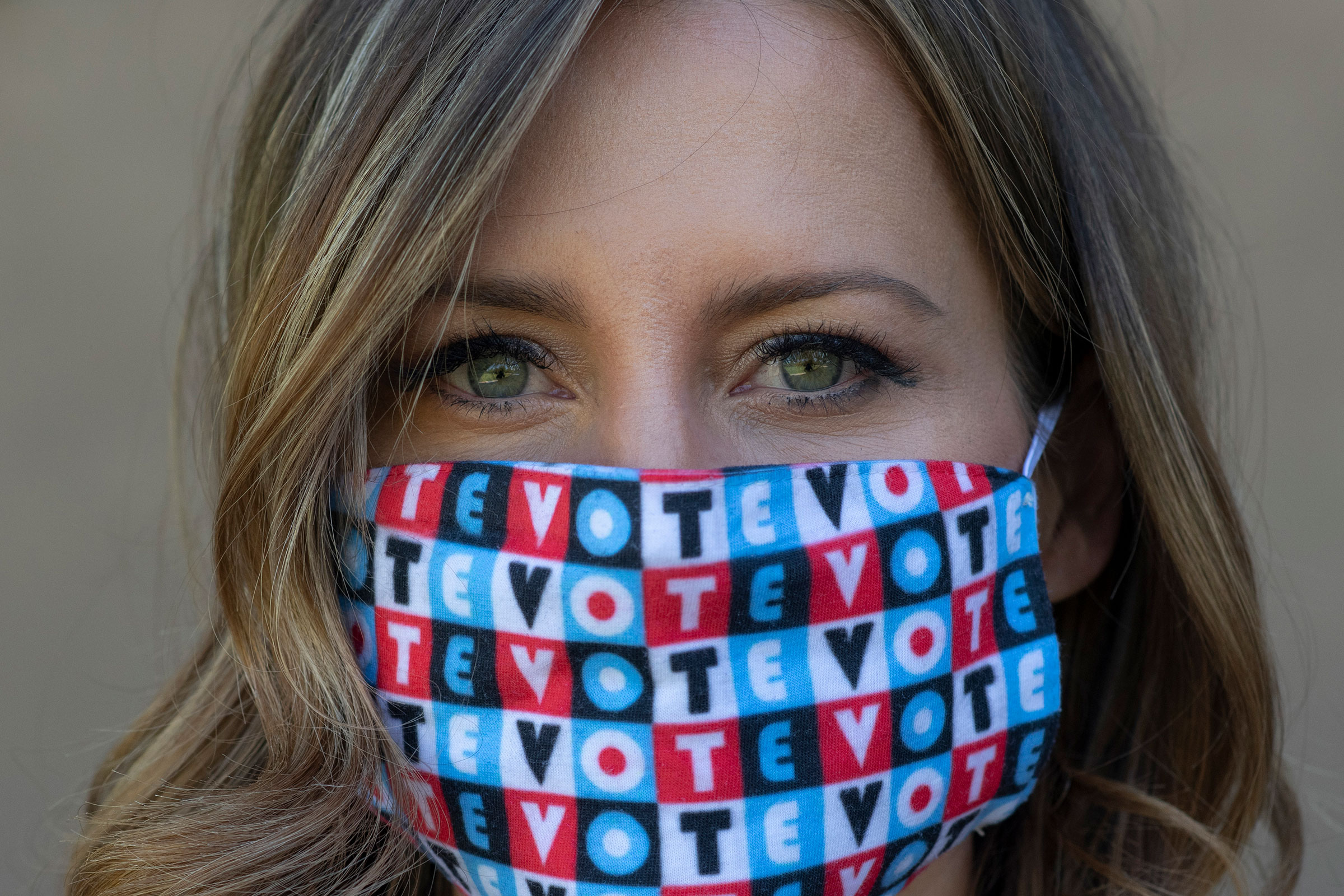 Amber McReynolds wearing a mask that says  vote  on Sept. 29, 2020.