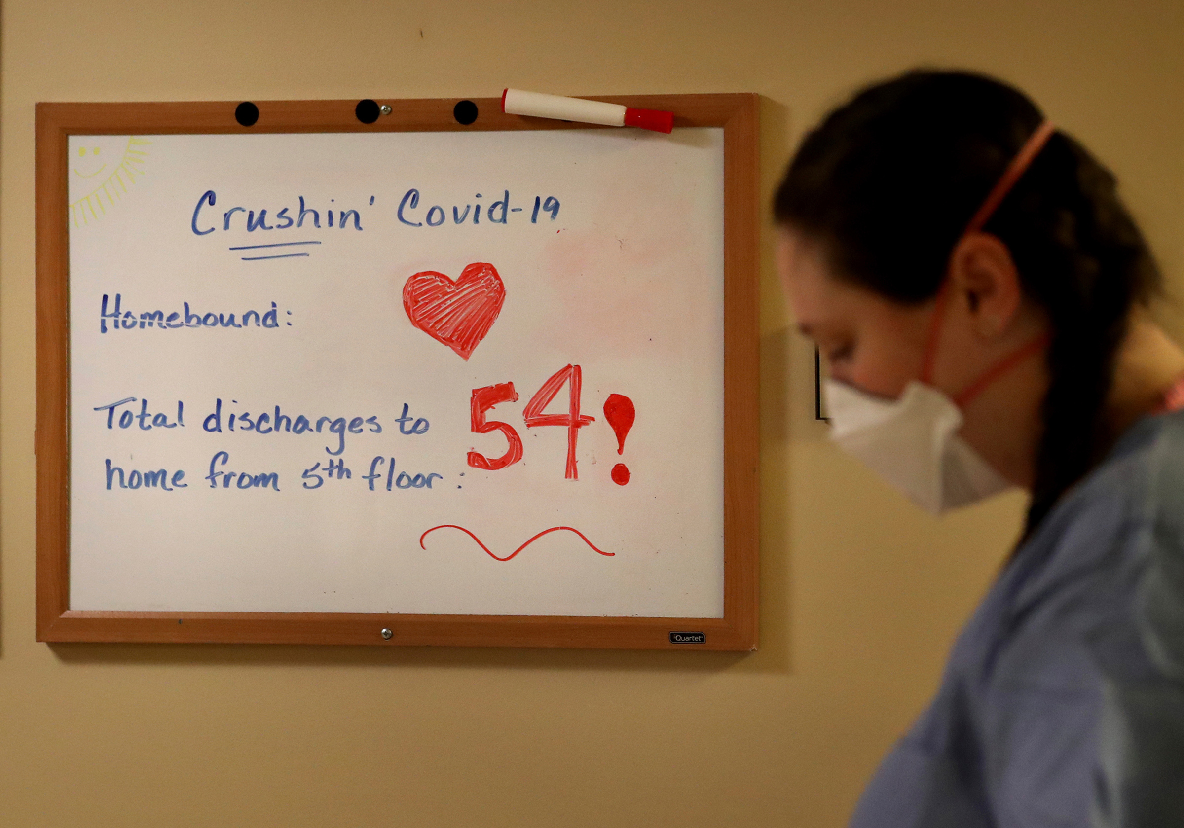 The number of COVID-19 patients recovered and discharged is tracked on a whiteboard on the fifth floor of the soon-to-be-closed Bethesda Hospital on May 7 in St. Paul