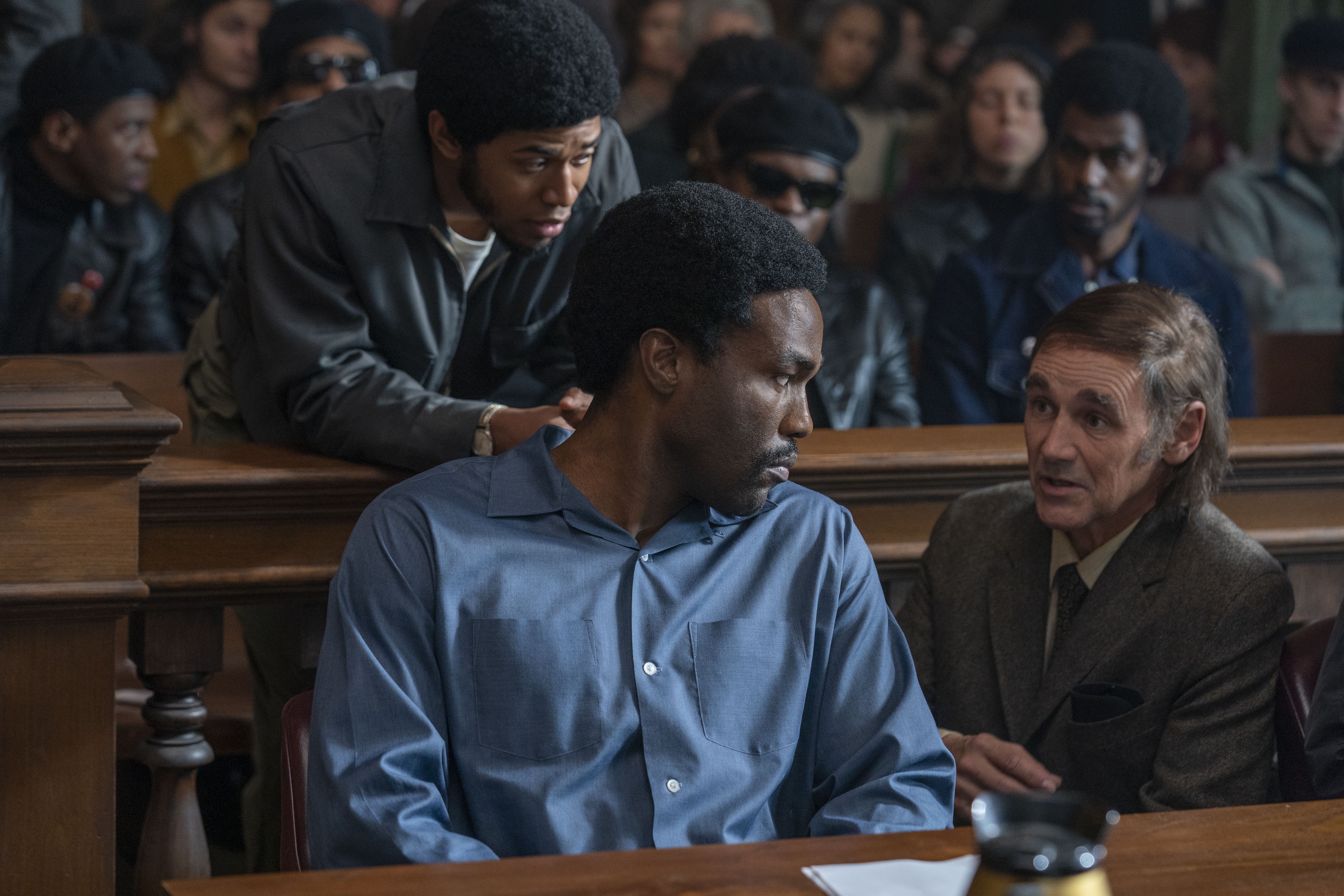 From left, Kelvin Harrison Jr., Yahya Abdul-Mateen II and Mark Rylance in  The Trial of the Chicago 7.