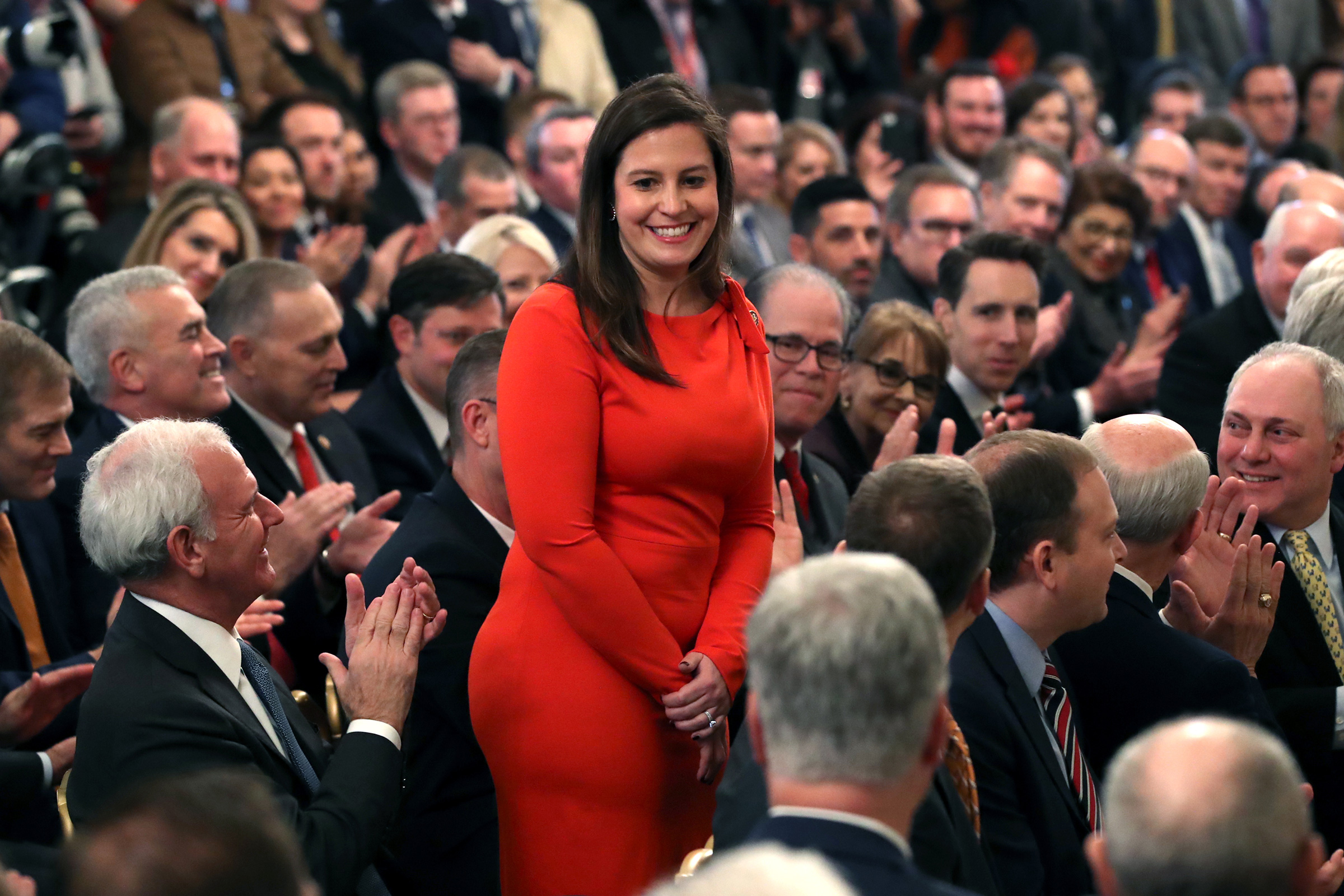 Republican Rep. Elise Stefanik stands as she's acknowledged by U.S. President Donald Trump as he speaks one day after the U.S. Senate acquitted on two articles of impeachment, in the East Room of the White House February 6, 2020 in Washington, DC.