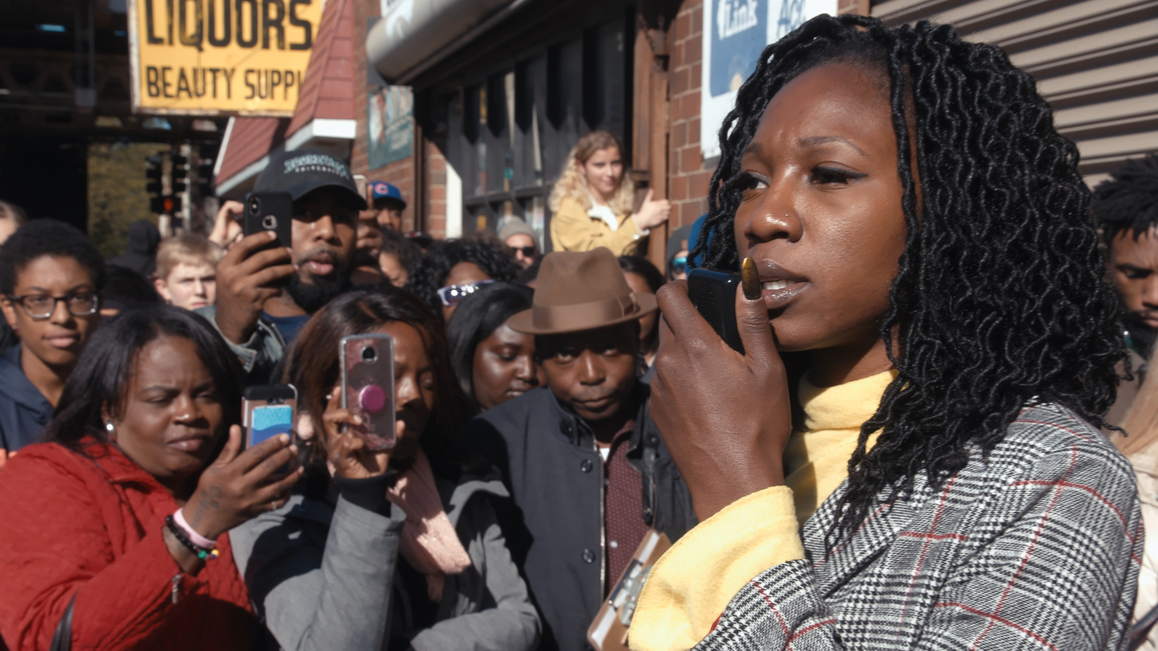 Amara Enyia holds a press conference with Chance the Rapper and Kanye West in Southside Chicago