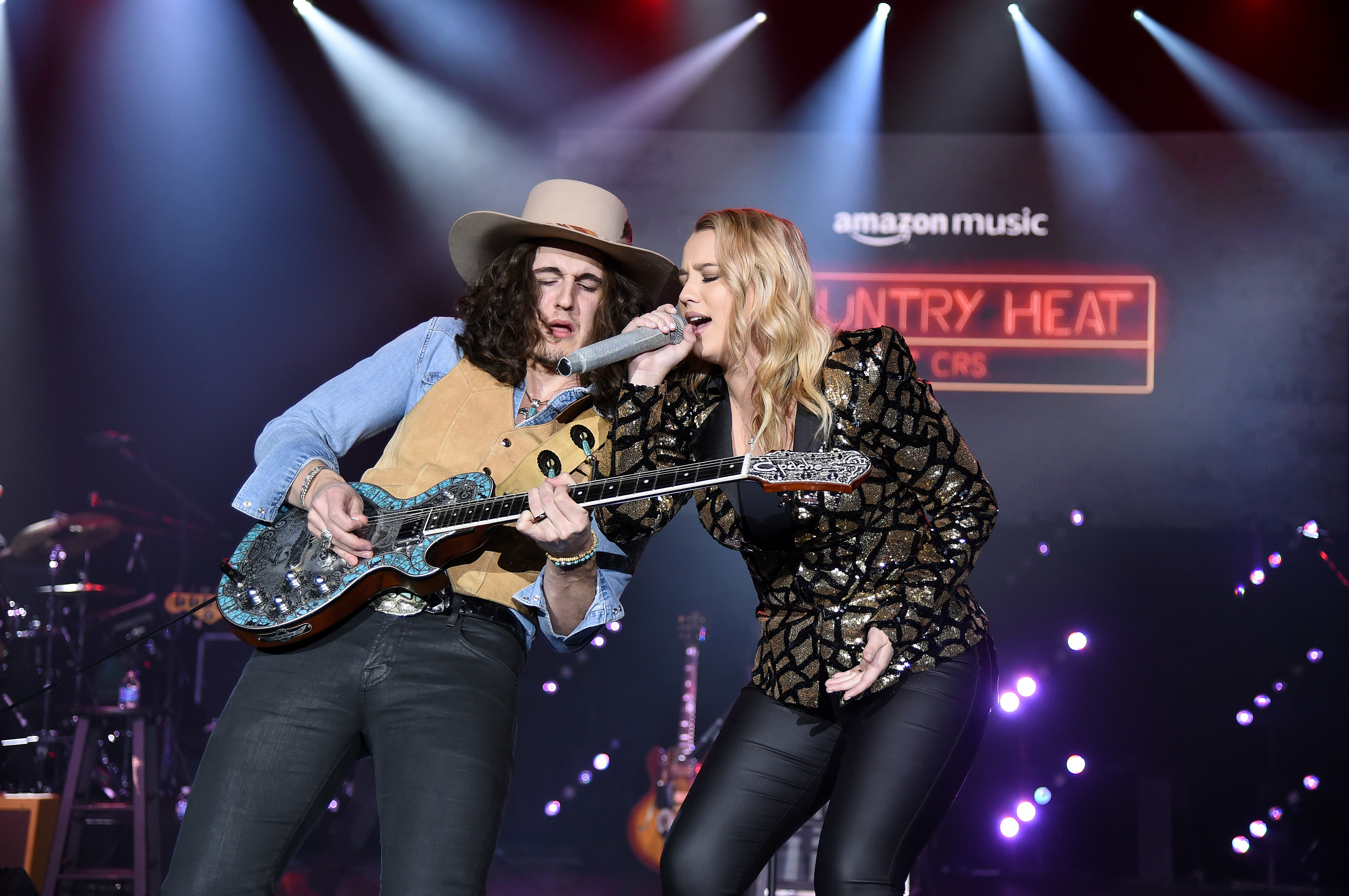 Gabby Barrett, right, performs in February in Nashville, Tennessee.