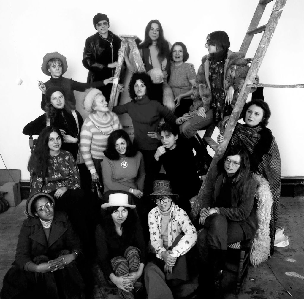 NEW YORK - 1974: Founding members of the first women's cooperative art gallery, A.I.R., from left to right, bottom to top: Howardena Pindell, Daria Dorosh, Maude Boltz, Rosemary Mayer, Mary Grigoriadis, Agnes Denes, Louise Kramer, Loretta Dunkelman, Barbara Zucker, Patsy Norvell, Sari Dienes, Judith Bernstein, Laurace James, Nancy Spero, Pat Lasch, Anne Healy, Dotty Attie. Taken at Daria Dorosh's loft, 370 Broadway, in 1974, in New York City, New York. (Photo by David Attie/Getty Images)