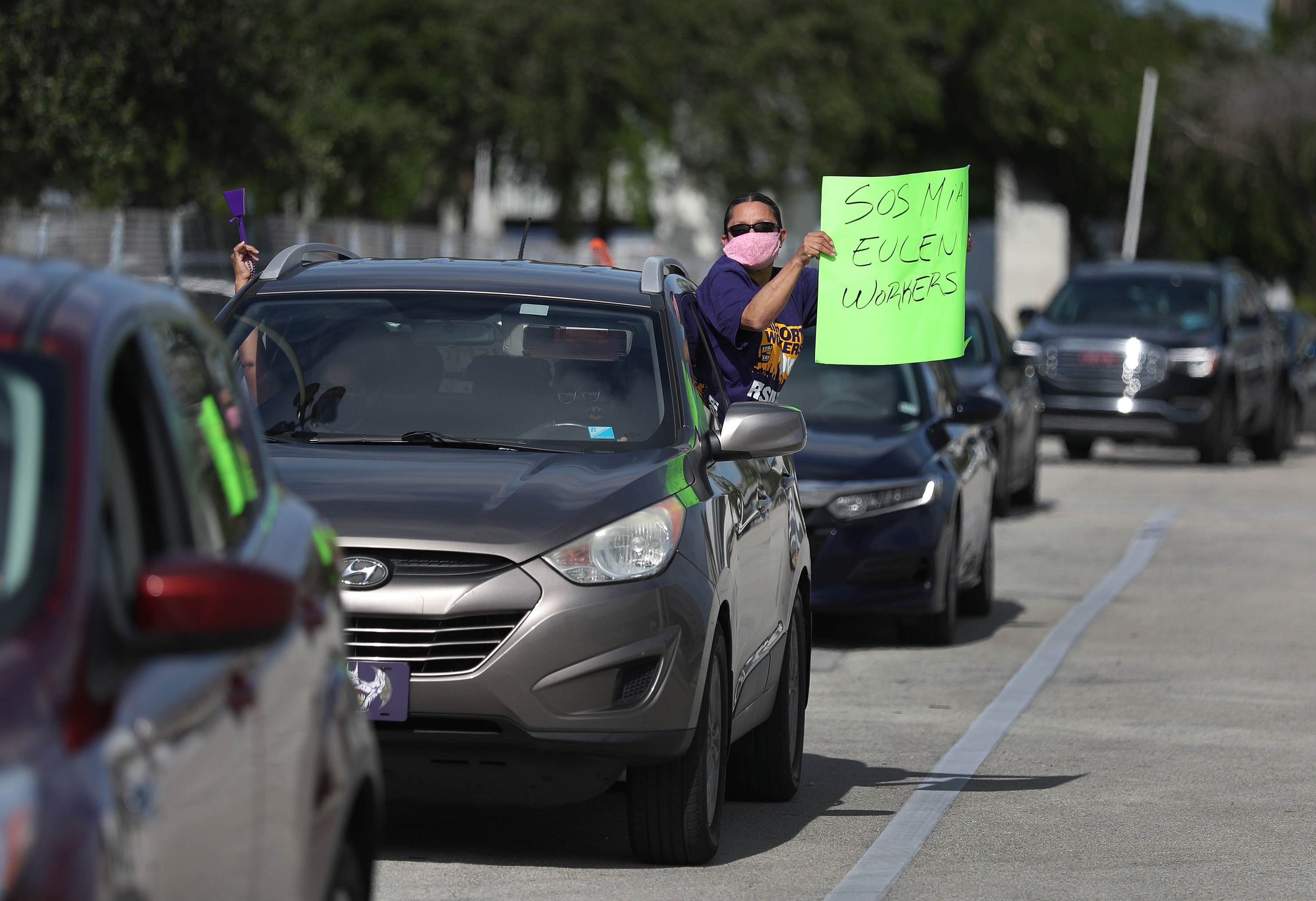 A protester at Miami International Airport on May 12, 2020, where workers were demonstrating against layoffs by the Eulen America aviation company.