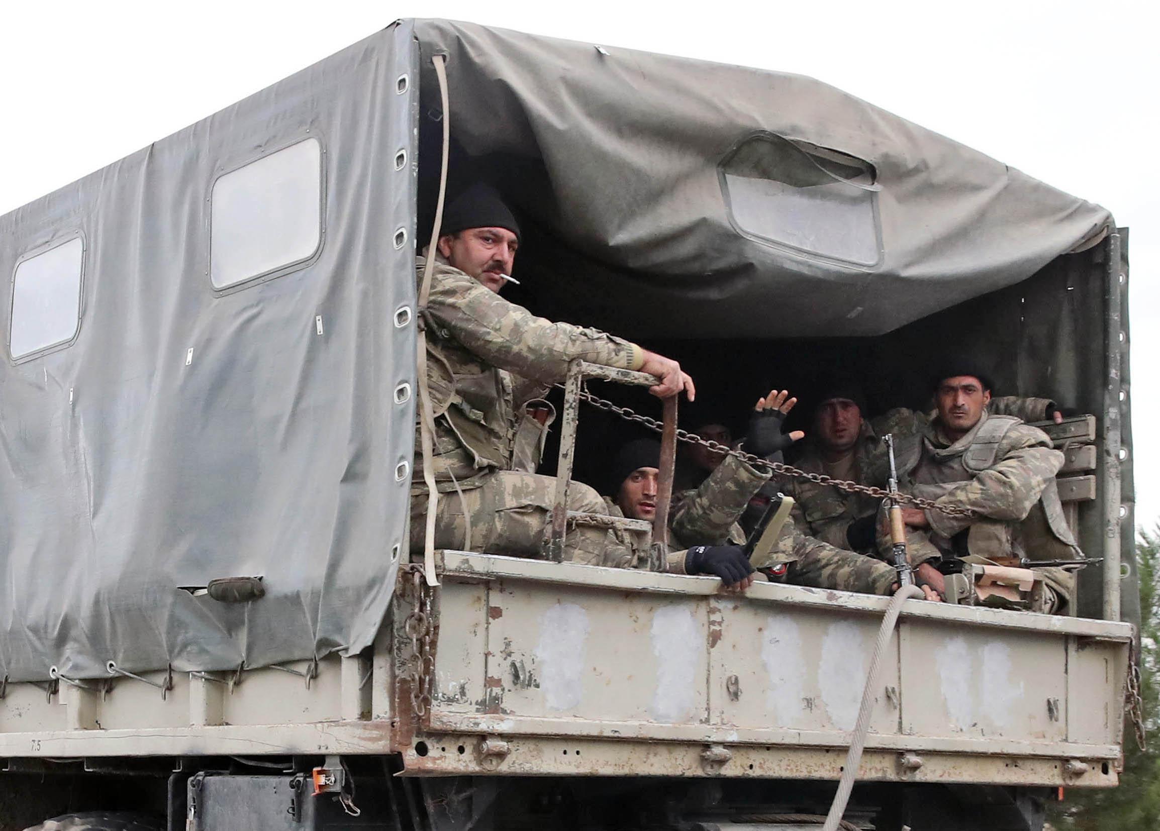BARDA, AZERBAIJAN - OCTOBER 5, 2020: Azerbaijani servicemen are pictured in a personnel carrier.