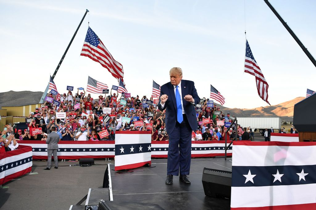 Donald Trump dances at the end of a rally at Carson City Airport in Carson City, Nevada on October 18, 2020.
