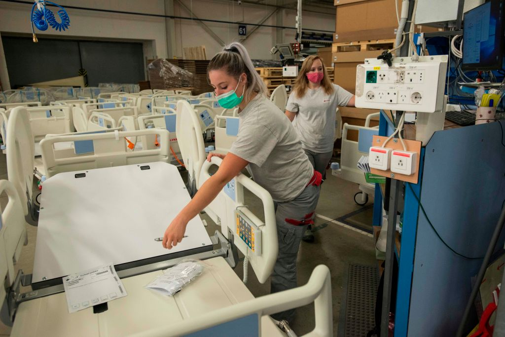 Employees of Czech hospital beds maker Linet check beds to be used in the COVID-19 field hospital on Oct. 20, 2020 in the Linet factory in the village Zelevcice, 30 km south-east of Prague.