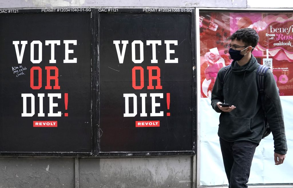 A man walks by a advertisement by REVOLT as they have relaunched Sean  Diddy  Combs' widely popular VOTE or DIE! initiative ahead of this year's general election on November 3, in the East Village in New York, New York, on October 20, 2020.