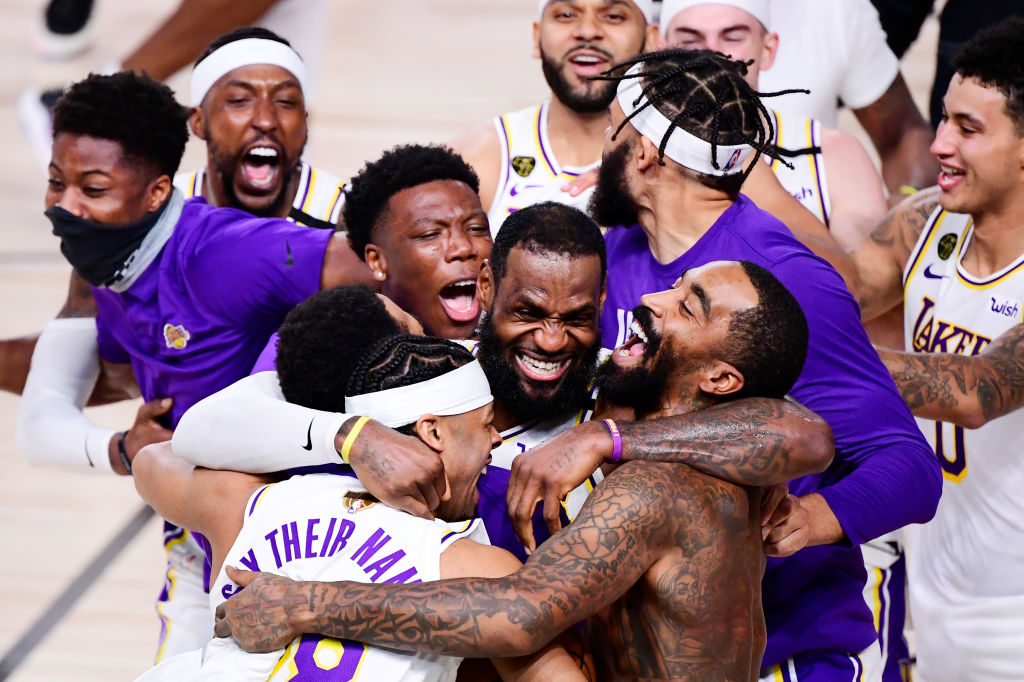 LeBron James, #23 of the Los Angeles Lakers, celebrates with Quinn Cook, #28 of the Los Angeles Lakers, and teammates after winning the 2020 NBA Championship in Game Six of the 2020 NBA Finals at AdventHealth Arena at the ESPN Wide World Of Sports Complex on October 11, 2020 in Lake Buena Vista, Florida.