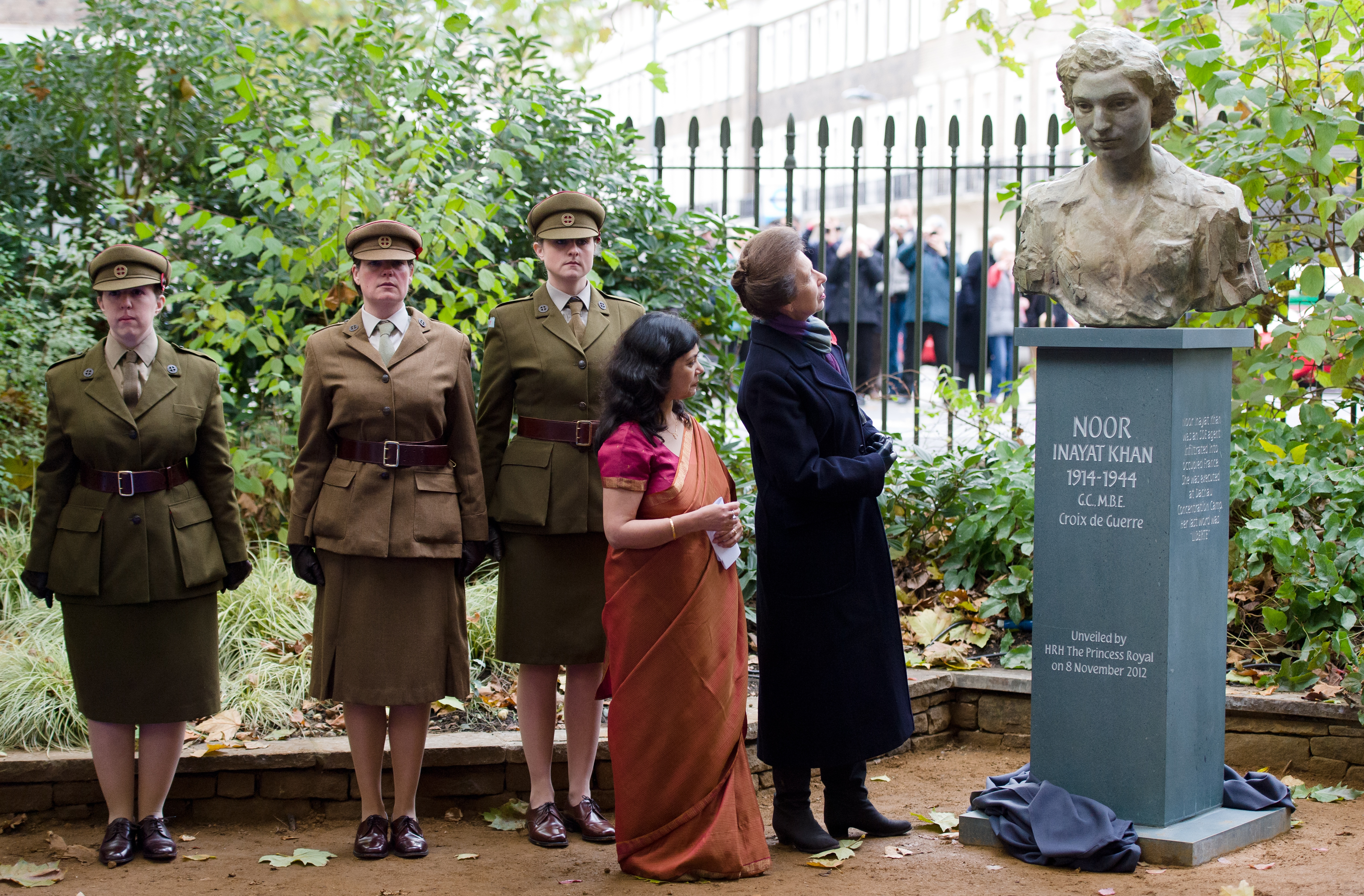 Britain's Princess Anne looks at a statue of Noor Inayat Khan after unveiling it in a ceremony in central London on November 8, 2012.