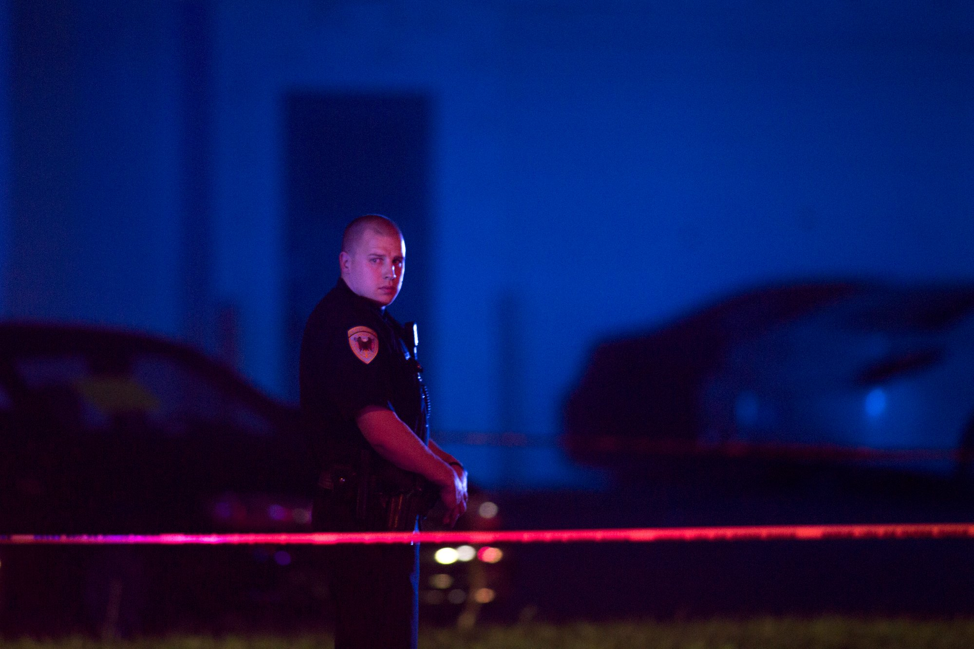 In this Sept. 7, 2016 photo, a police officer guards the scene after a police officer fatally shot a man who was suspected of stealing a semi-automatic pistol from a gun store in Wyoming, Mich., in the suburbs of Grand Rapids. Community leaders in Grand Rapids say the police can only do so much. They're looking for more proactive measures as opposed to reactive ones.