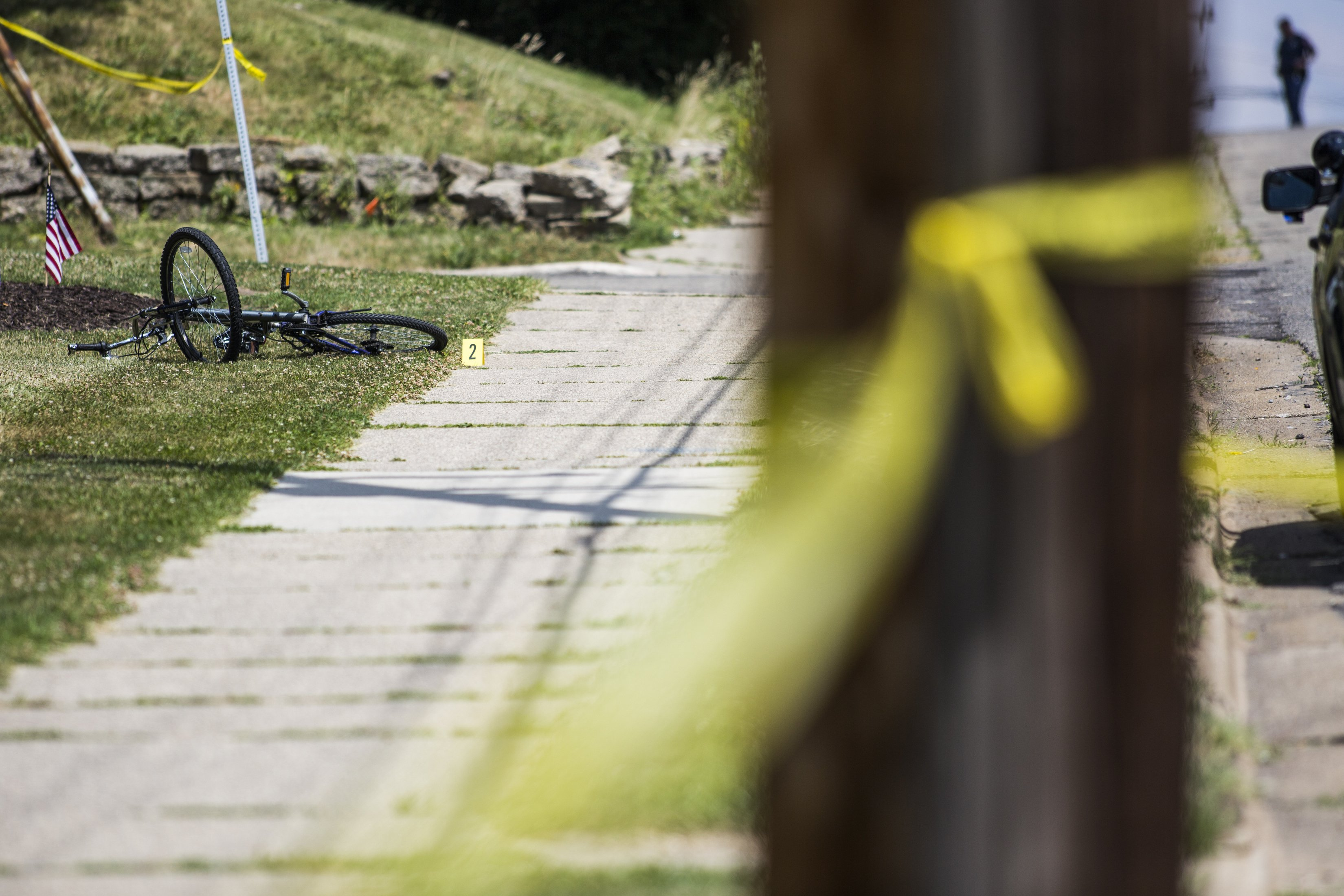 A bike is marked as evidence at the scene of a shooting on June 30, 2016 in Grand Rapids, Mich. In one of the worst periods of violence in 2020 for the city, 11 people were shot across the weekend of Sept. 12 and 13. Grand Rapids police responded by placing over 100 officers on the streets the following weekend, during which they collected 10 illegal weapons and made 16 felony arrests.